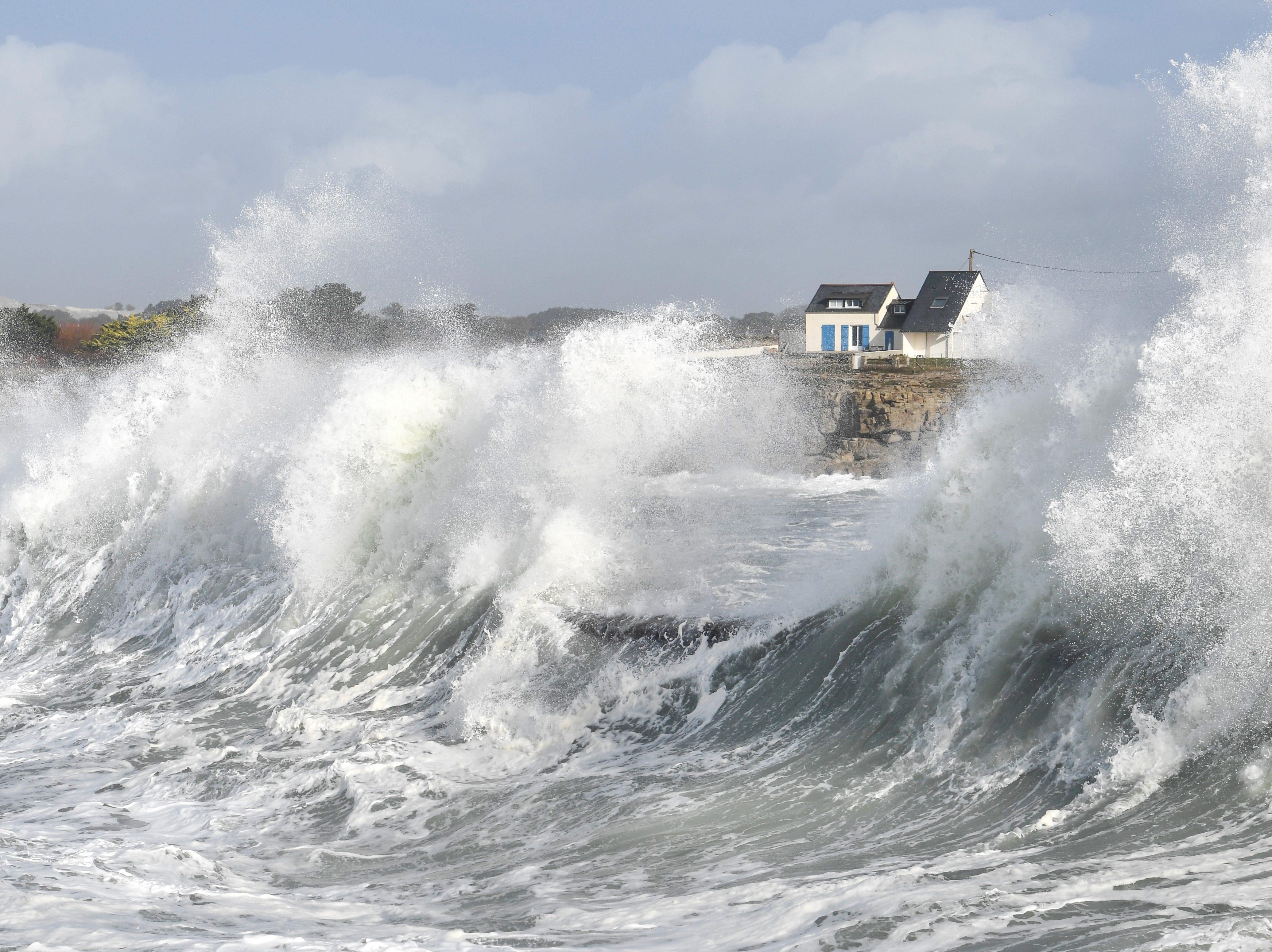 Waves break on the jetty in Ploemeur, western France, November 29, 2018.