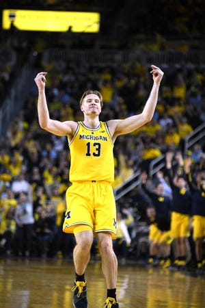 Michigan's Ignas Brazdeikis fires up the crowd during the first half