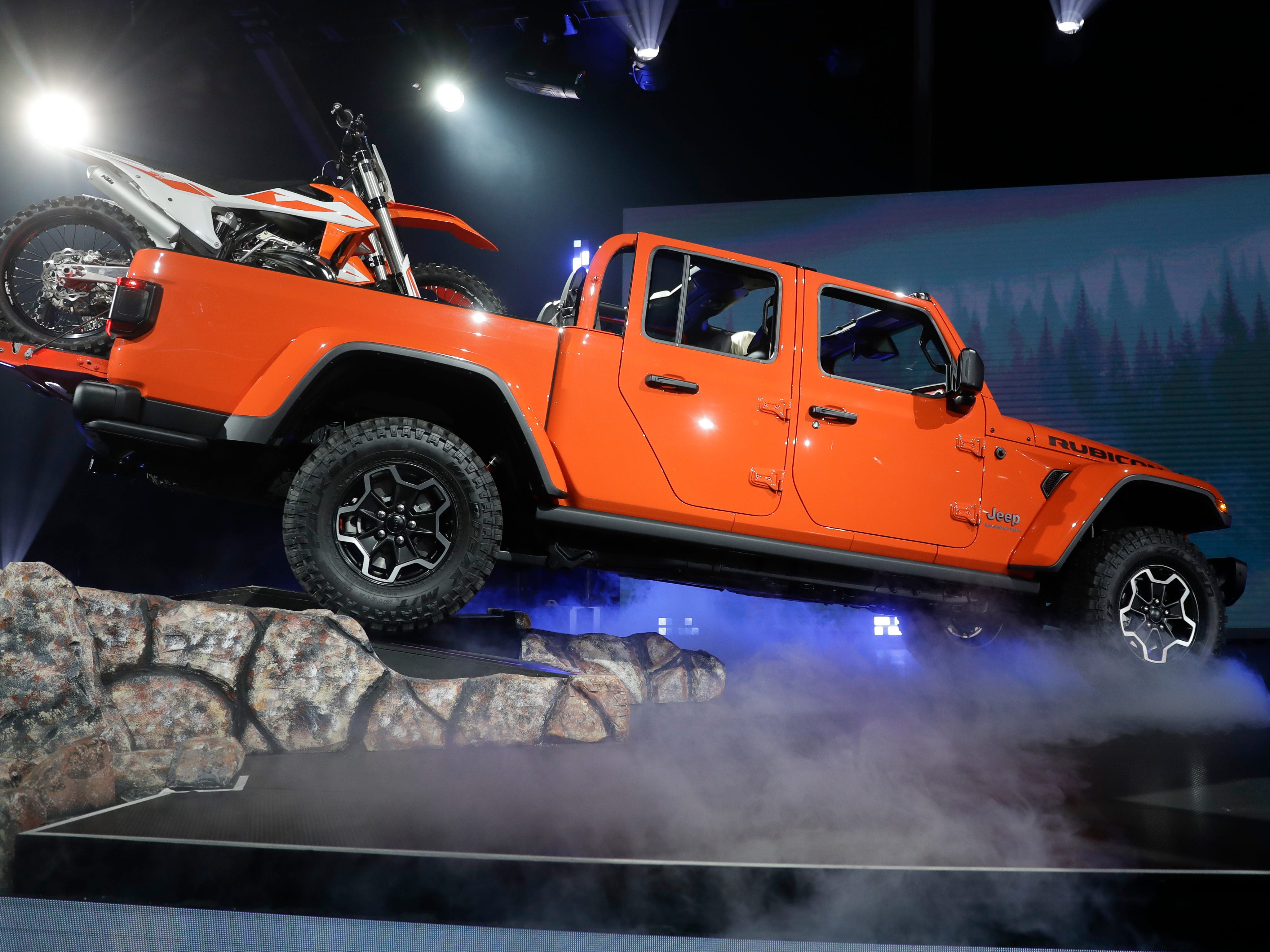 A 2020 Jeep Gladiator Rubicon climbs into the stage during the Los Angeles Auto Show on Wednesday.