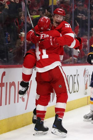 Tyler Bertuzzi of the Detroit Red Wings celebrates his second-period goal with Luke Glendening.