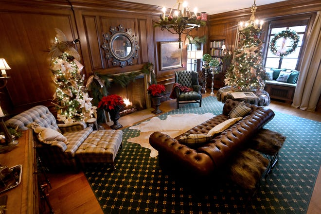 Volunteers are decorating Earhart Manor for Christmas, on the campus of Concordia University in Ann Arbor. The study, seen here, will be included in public tours  this weekend.