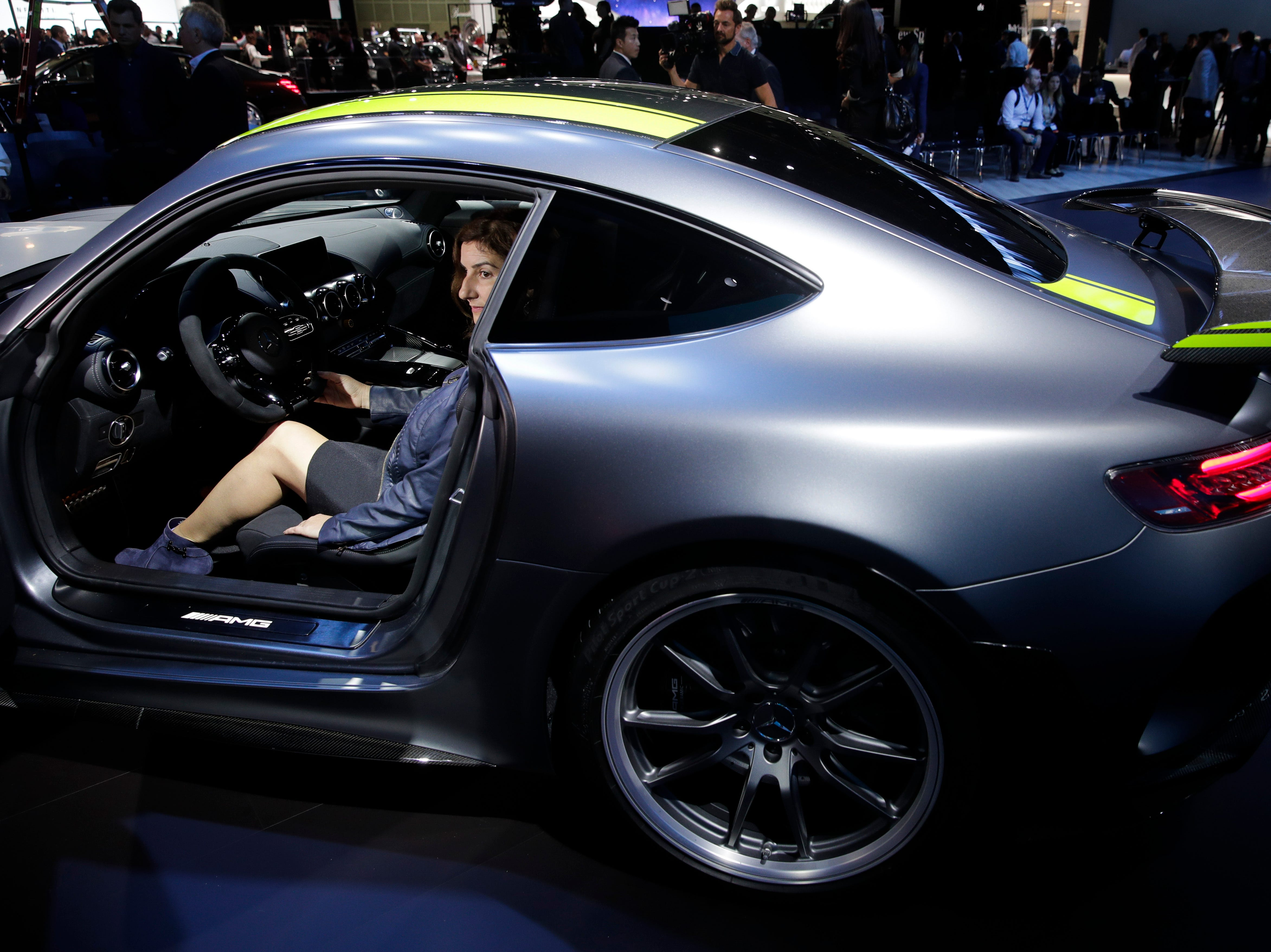 A woman sits in the 2020 Mercedes-AMG GT R Pro at the Los Angeles Auto Show Wednesday, Nov. 28, 2018, in Los Angeles.