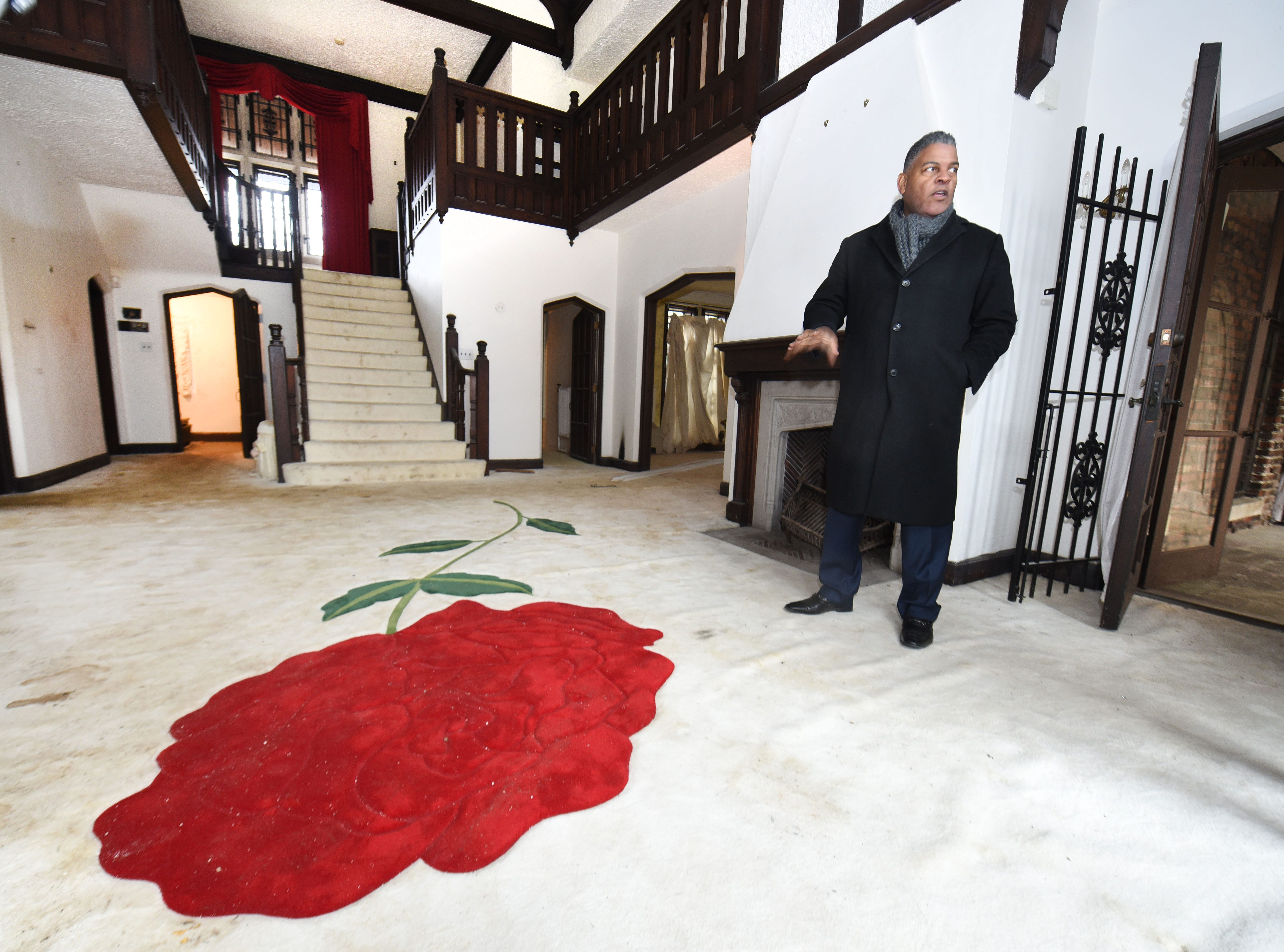 """Anthony Kellum, president of Kellum Mortgage in Troy, is the buyer of the recently sold house.  He stands in the grand living space, adorned by a giant rose, in tribute to the singer's collaboration with Lauryn Hill on the 1998 album """"A Rose Is Still a Rose.""""  The house became known as the Rose Estate."""
