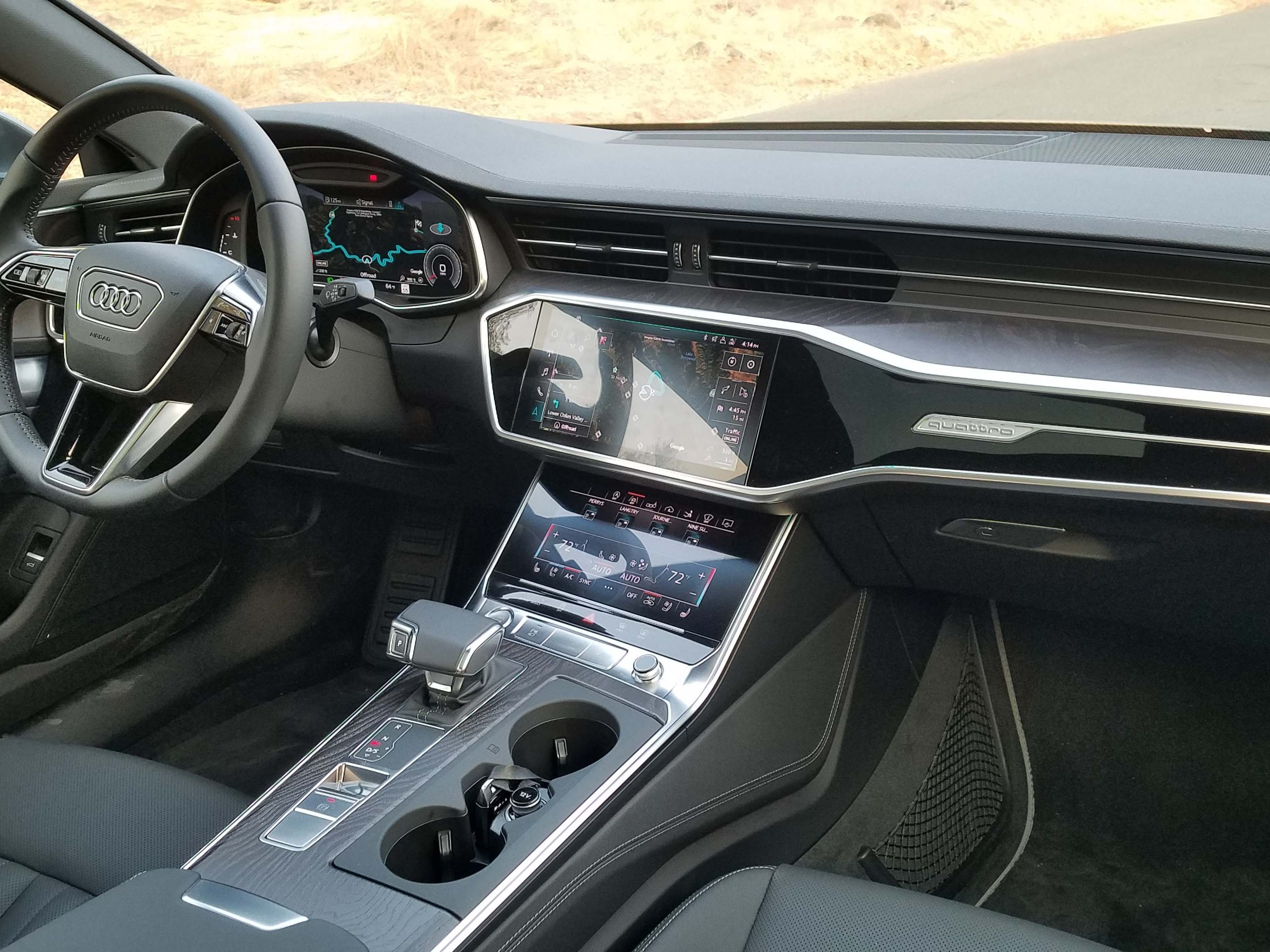 The Audi A7 features the brand's latest touch screen technology (10.1- inch upper and 8.6-inch lower) that ditches the old familiar rotary dial. Console storage room, however, is still sparse.