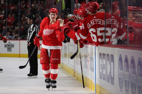 Tyler Bertuzzi of the Detroit Red Wings celebrates his third-period goal with teammates on Wednesday night.