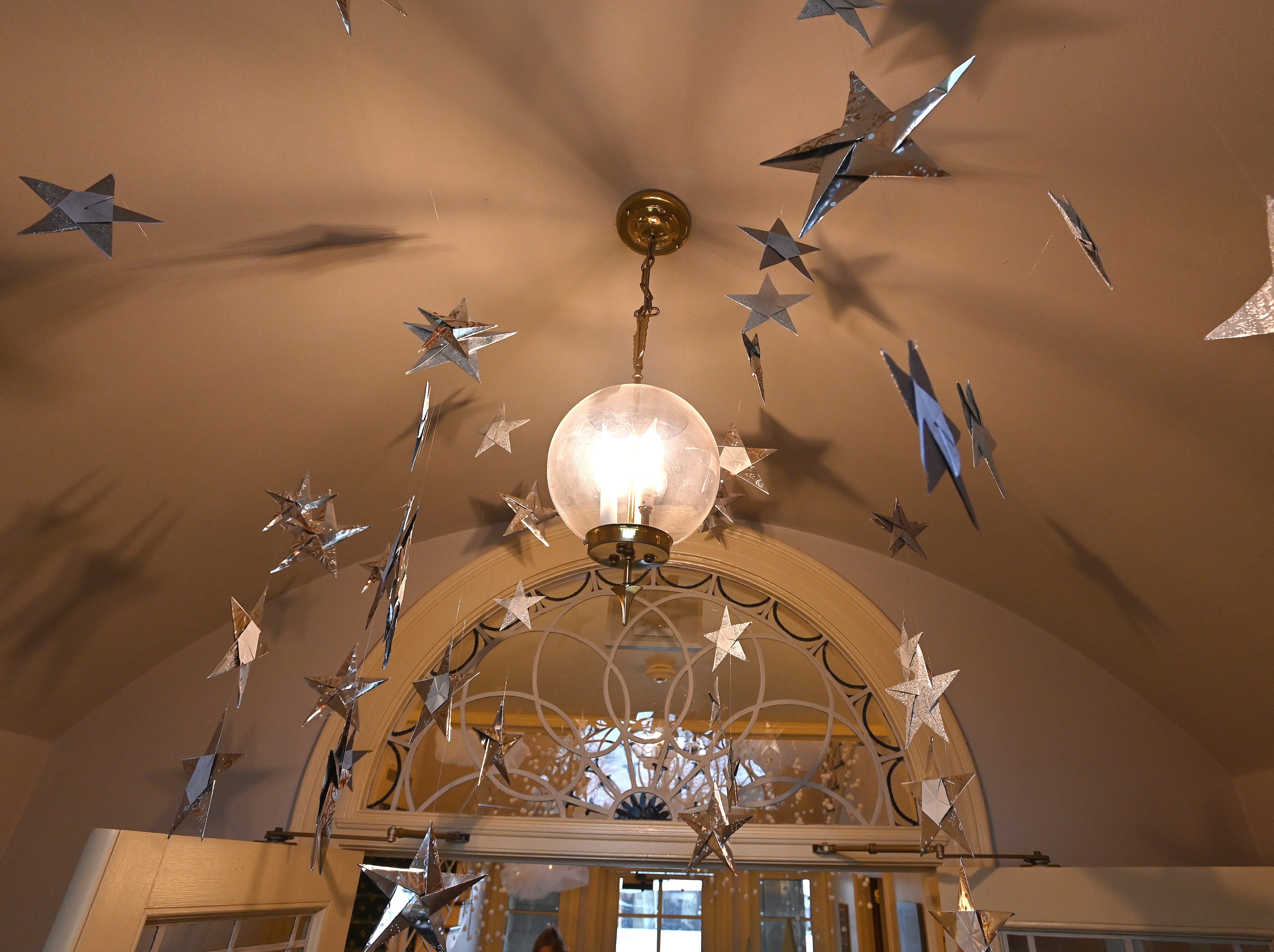 The entry greets visitors with whimsical stars hung from the ceiling.