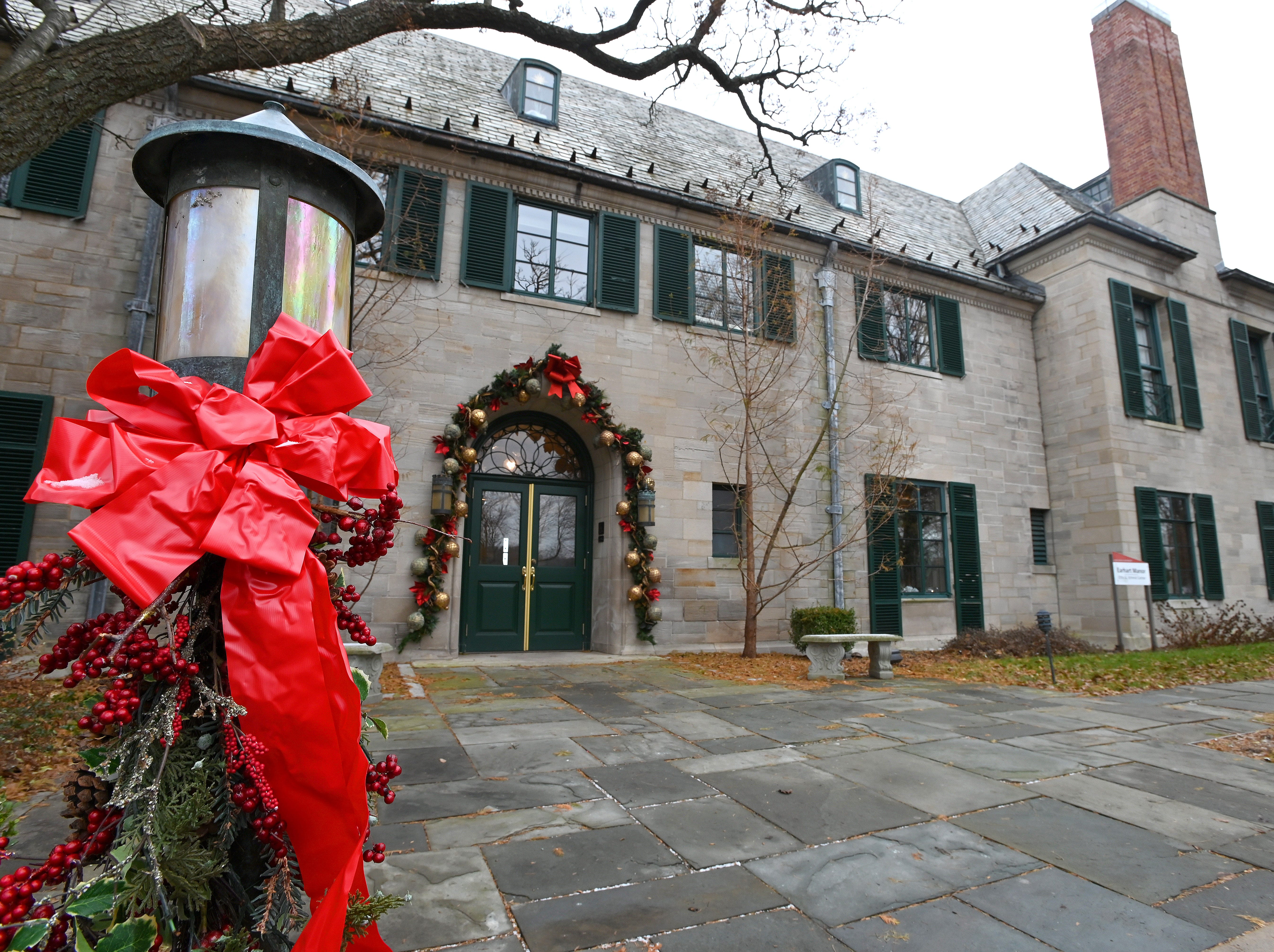 The main door to the Earhart Manor is wreathed in Christmas colors as volunteers get to work decorating the manor on the campus of Concordia University in Ann Arbor on Thursday, Nov 29, 2018.  The manor and all its Christmas decorations will be on display for visitors this weekend, Nov 30-Dec 2.