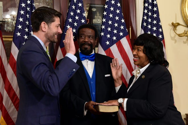 House Speaker Paul Ryan of Wisconsin enacts the ceremonial swearing-in of Rep.-elect Brenda Jones, D-Detroit, as the Rev. John Pitts, center, holds the Bible on Capitol Hill in Washington, Thursday.