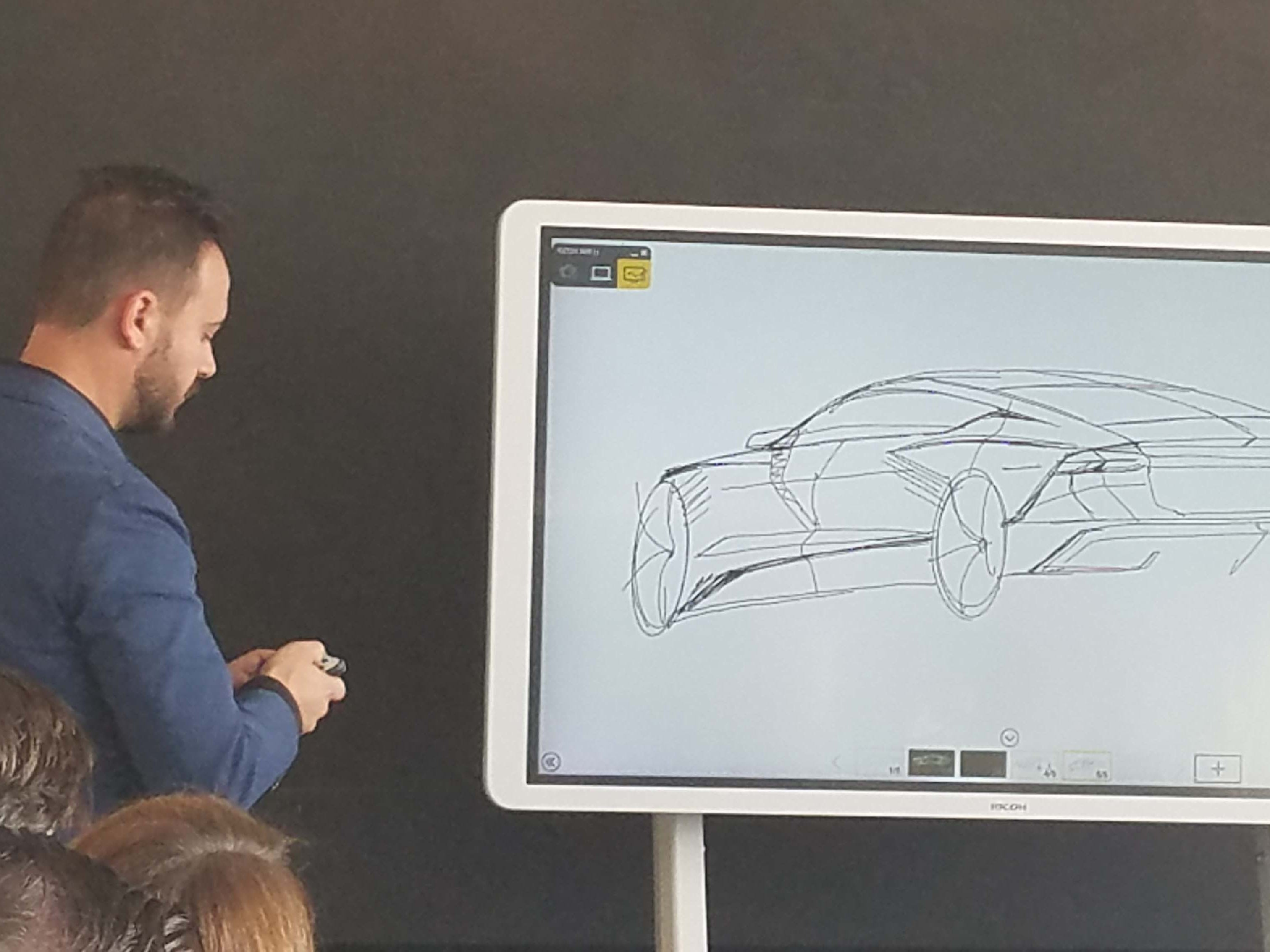 Audi A7 designer Sebastiano Russo sketches the sportback design on a digital pad.