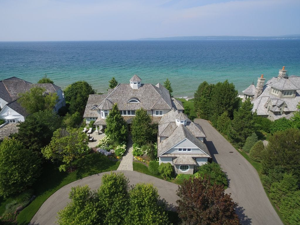 This $9.45 million, two-story Petoskey home is in a gated community and has 130 feet of frontage on Lake Michigan on one side and 130 feet of frontage on Bay Harbor Lake.