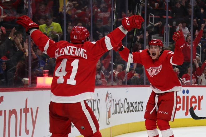 Tyler Bertuzzi of the Detroit Red Wings celebrates his second-period goal with Luke Glendening on Wedesday night.