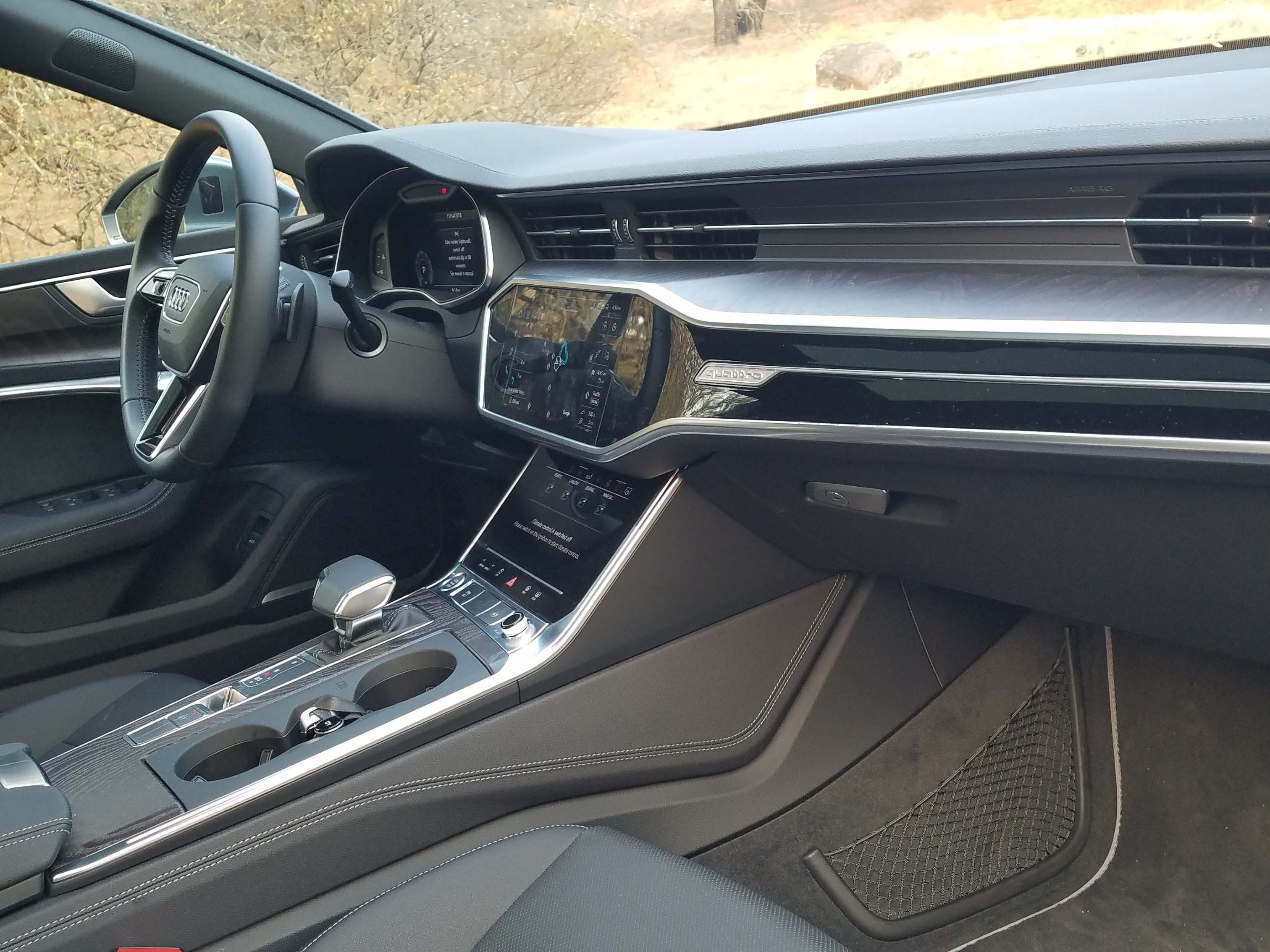 The interior of the 2019 Audi A7, shared with the Audi A6, is a dramatic departure from the previous generation with a guitar-like design dominating the dash and two touch screens where there used to be one.