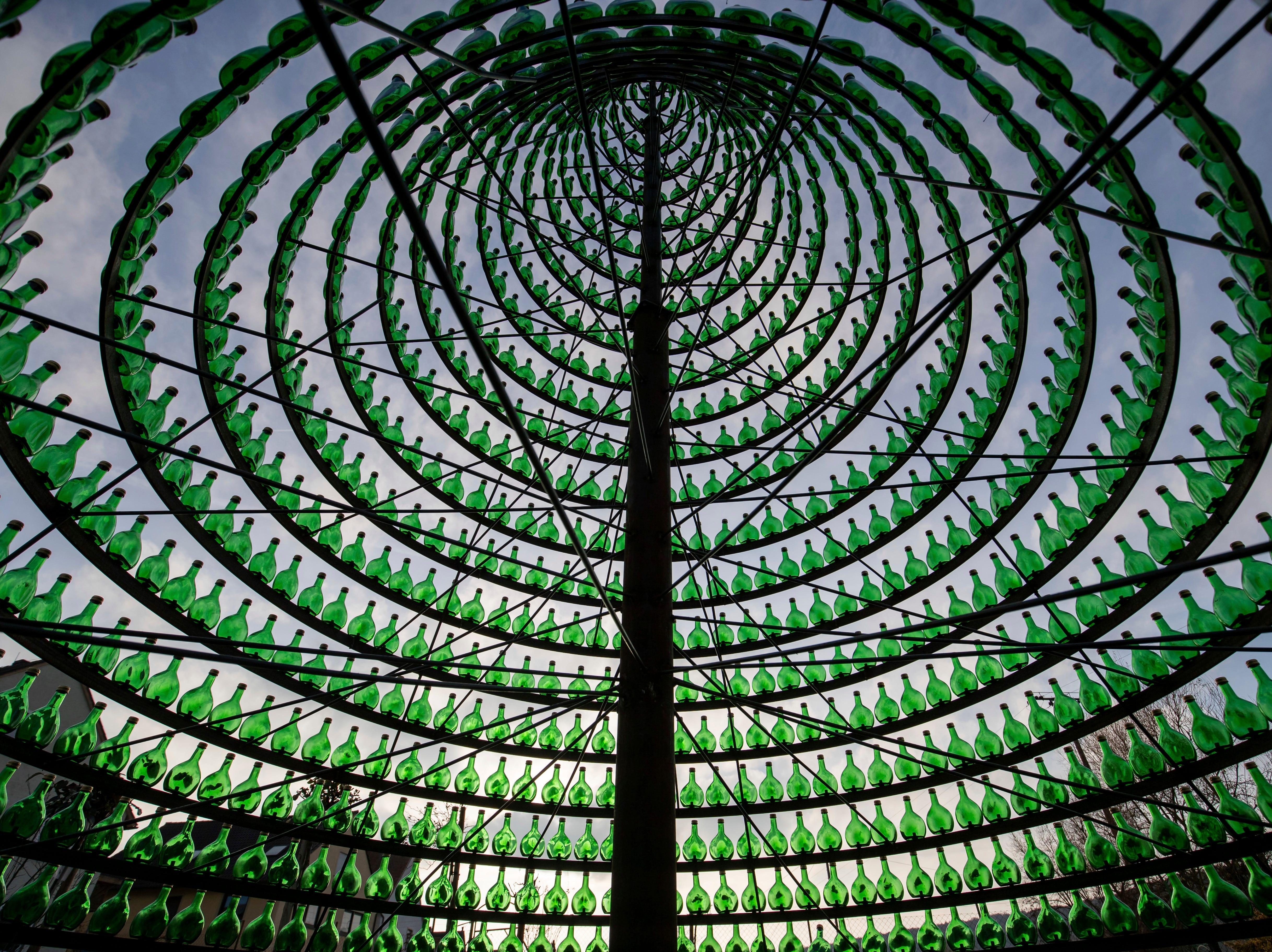 The Nov. 28, 2018, photo shows the inside of a Christmas tree made from 1099 Bocksbeutel wine bottles in Nordheim am Main, southern Germany. The bottles with the distinctive round body are typical for the Frankonian wine region.