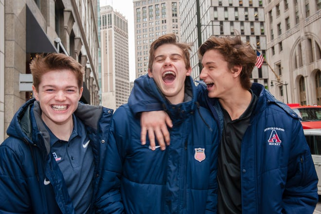 Top-rated NHL draft prospect Jack Hughes, center, jokes around with his linemates Cole Caufield, left, and Trevor Zegras, in downtown Detroit.  They are teammates on the U.S. National Under-18 Team.