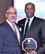 Guthrie President and CEO Dr. Joseph Scopelliti, left, presents the Donald Guthrie Distinguished Provider Award to Dr. Bruce Greene.