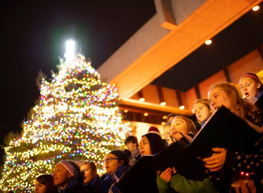 The Reitz Memorial High School Choir performs during the  City of Evansville's annual Christmas Tree lighting ceremony outside the Civic Center Wednesday evening.