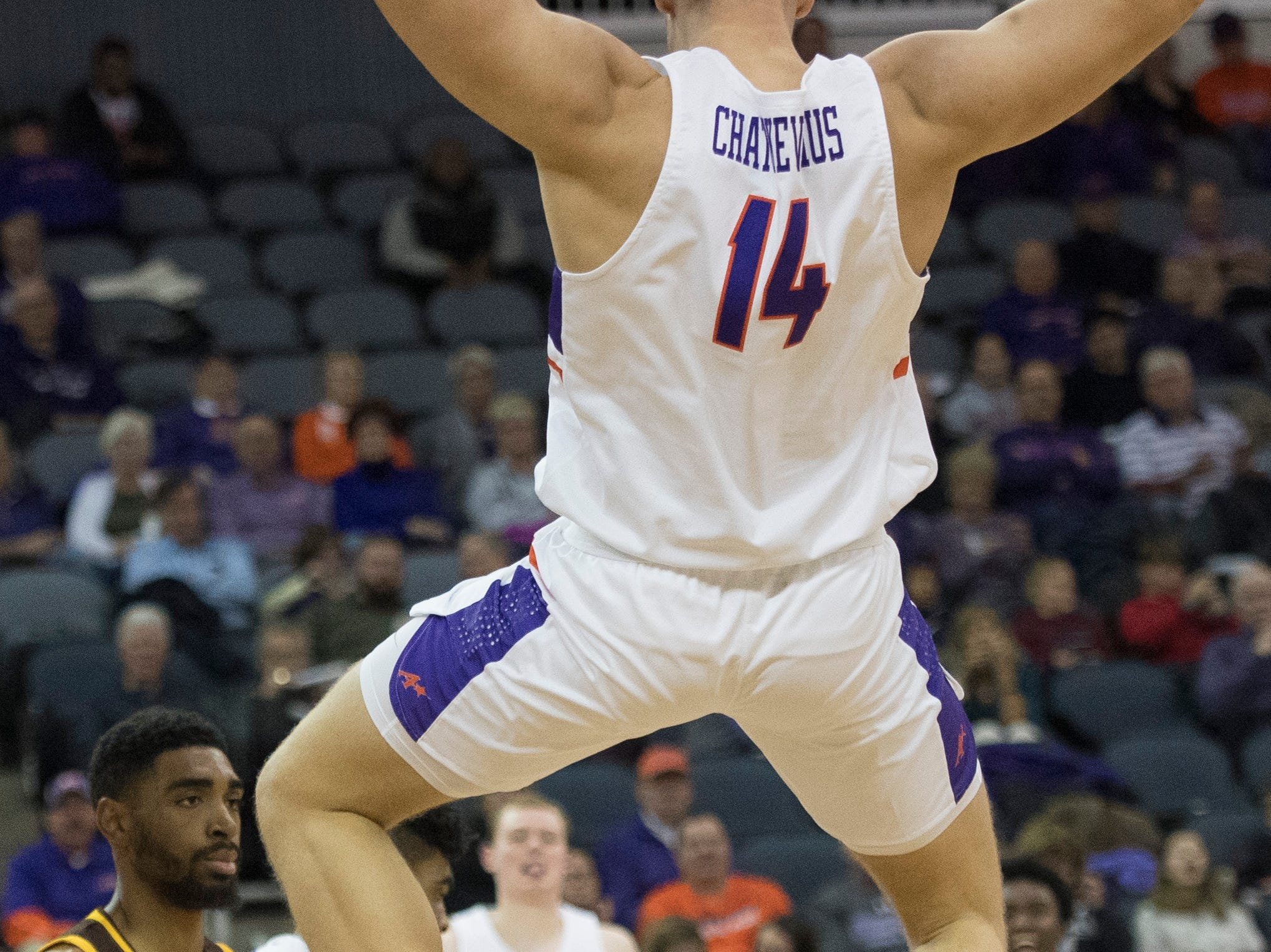 UE's Dainius Charkevicius (14) falls from the rim after a dunk  during the UE vs Wyoming game at the Ford Center Wednesday, Nov. 28, 2018. UE won 86-76.