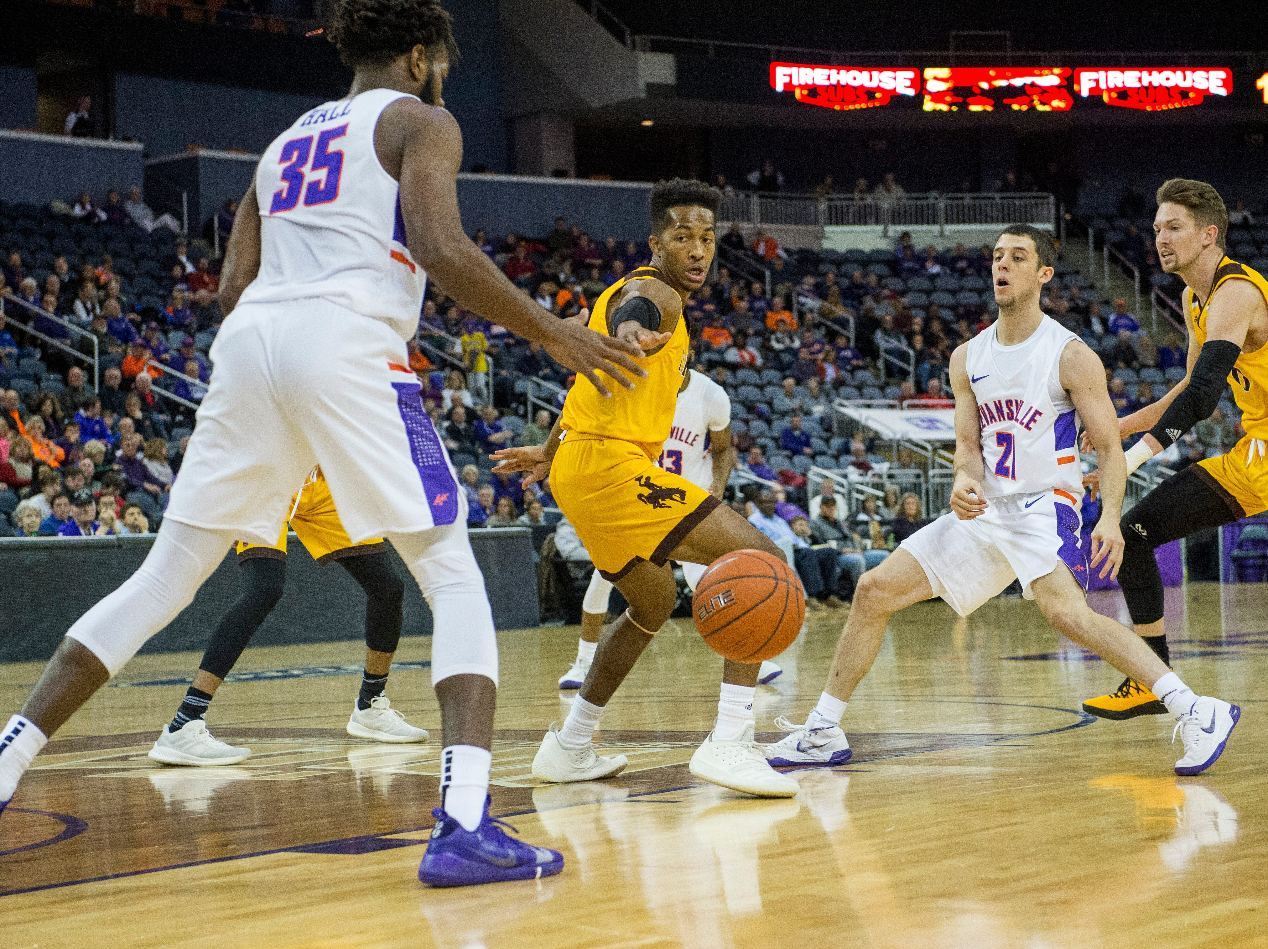UE's Shea Feehan (21) passes the ball to UE's John Hall (35) during the UE vs Wyoming game at the Ford Center Wednesday, Nov. 28, 2018. UE won 86-76.