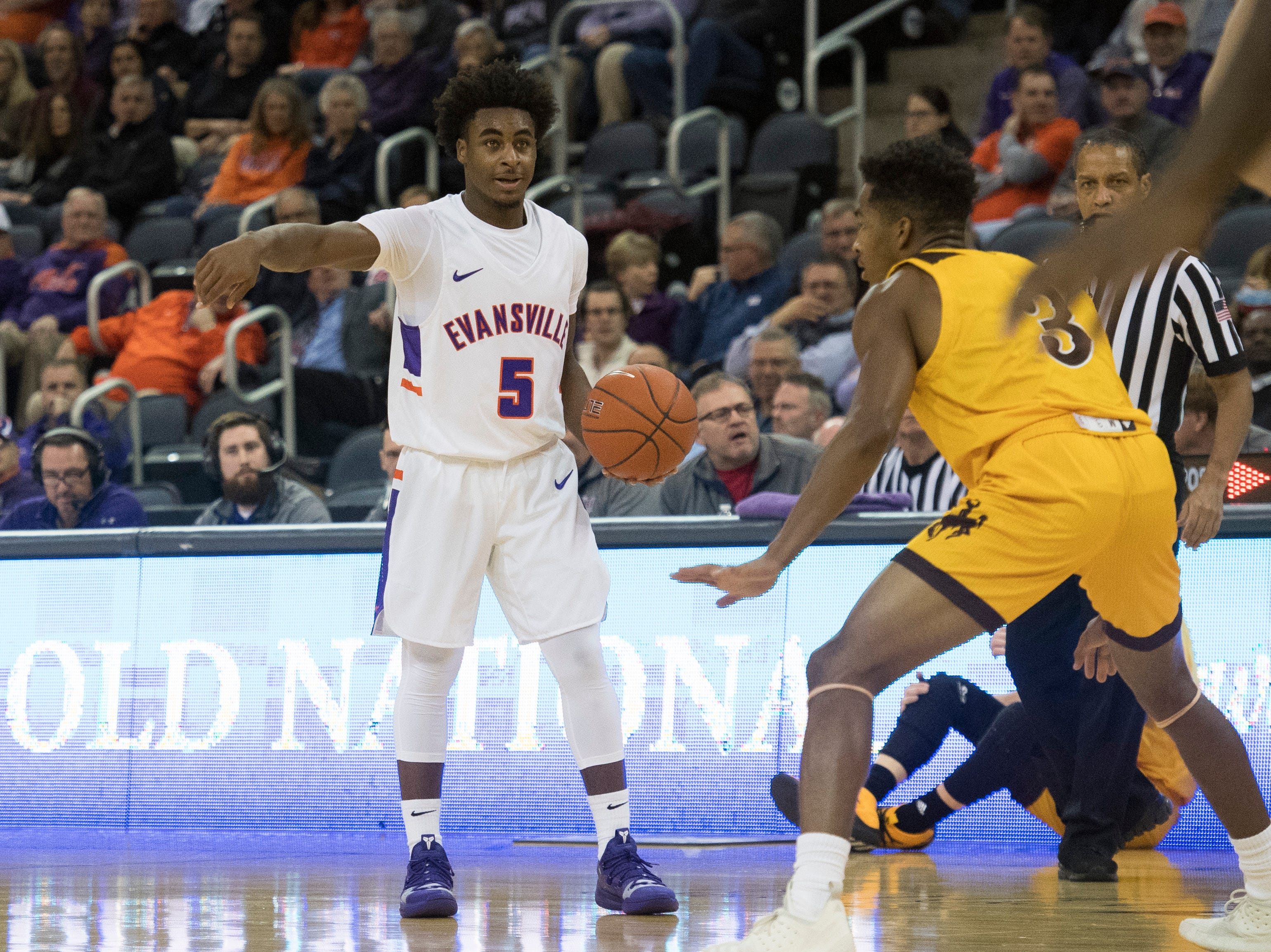 UE's Shamar Givance (5) communicates with a teammate during the UE vs Wyoming game at the Ford Center Wednesday, Nov. 28, 2018. UE won 86-76.
