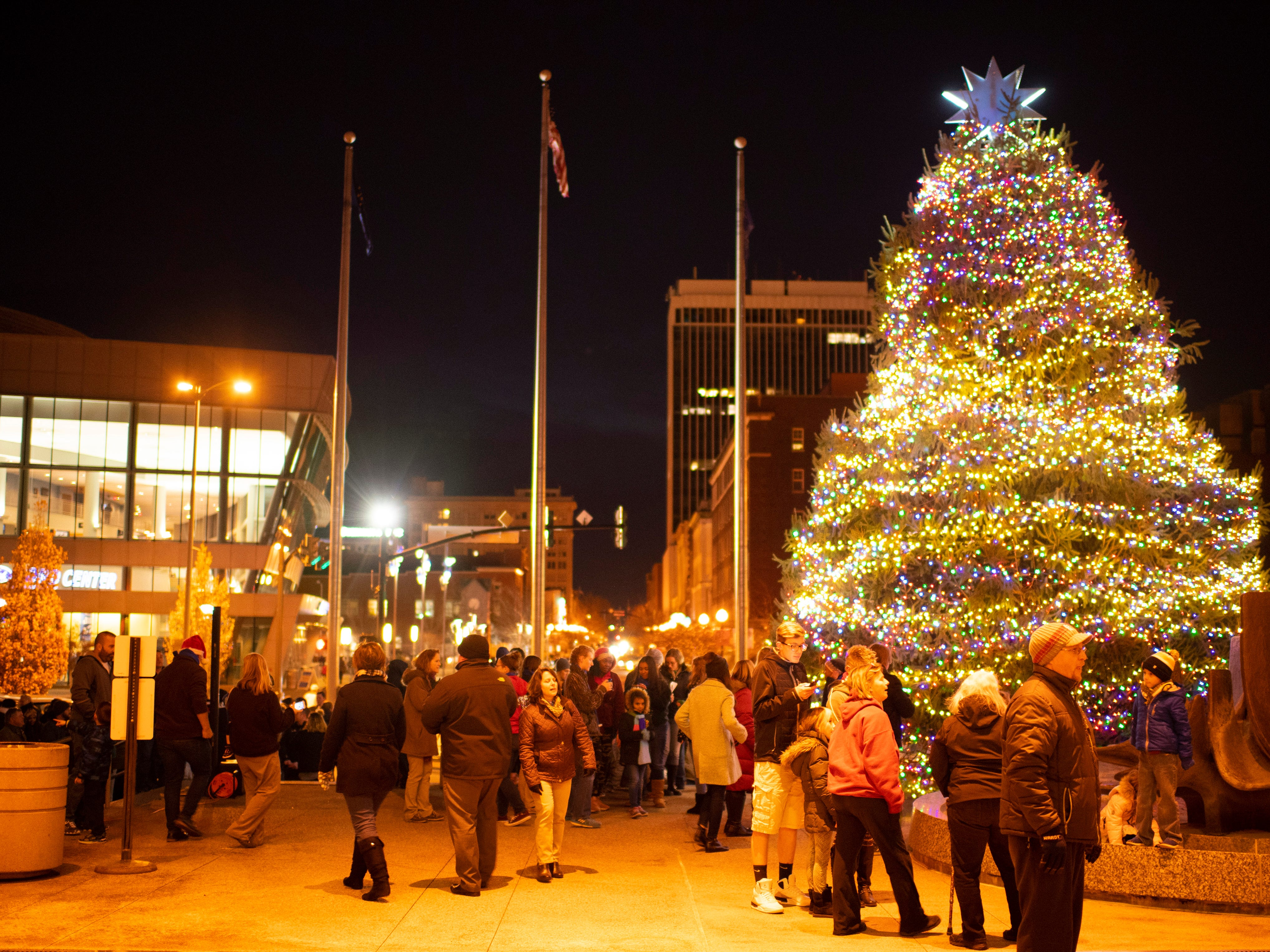 About 200 people showed up for the  City of Evansville's annual Christmas Tree lighting ceremony outside the Civic Center Wednesday evening.