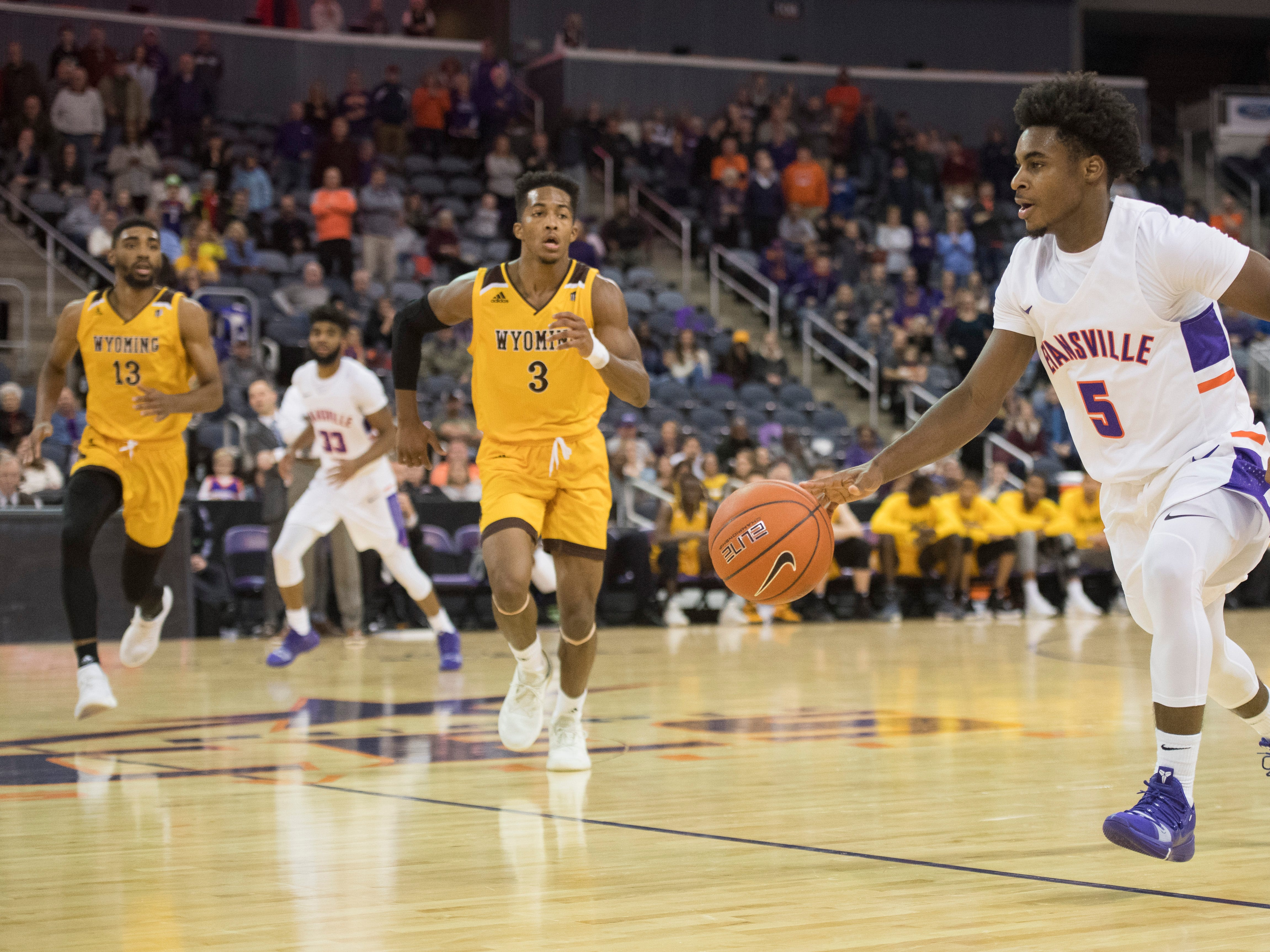 UE's Shamar Givance (5) dribbles the ball up court during the UE vs Wyoming game at the Ford Center Wednesday, Nov. 28, 2018. UE won 86-76.