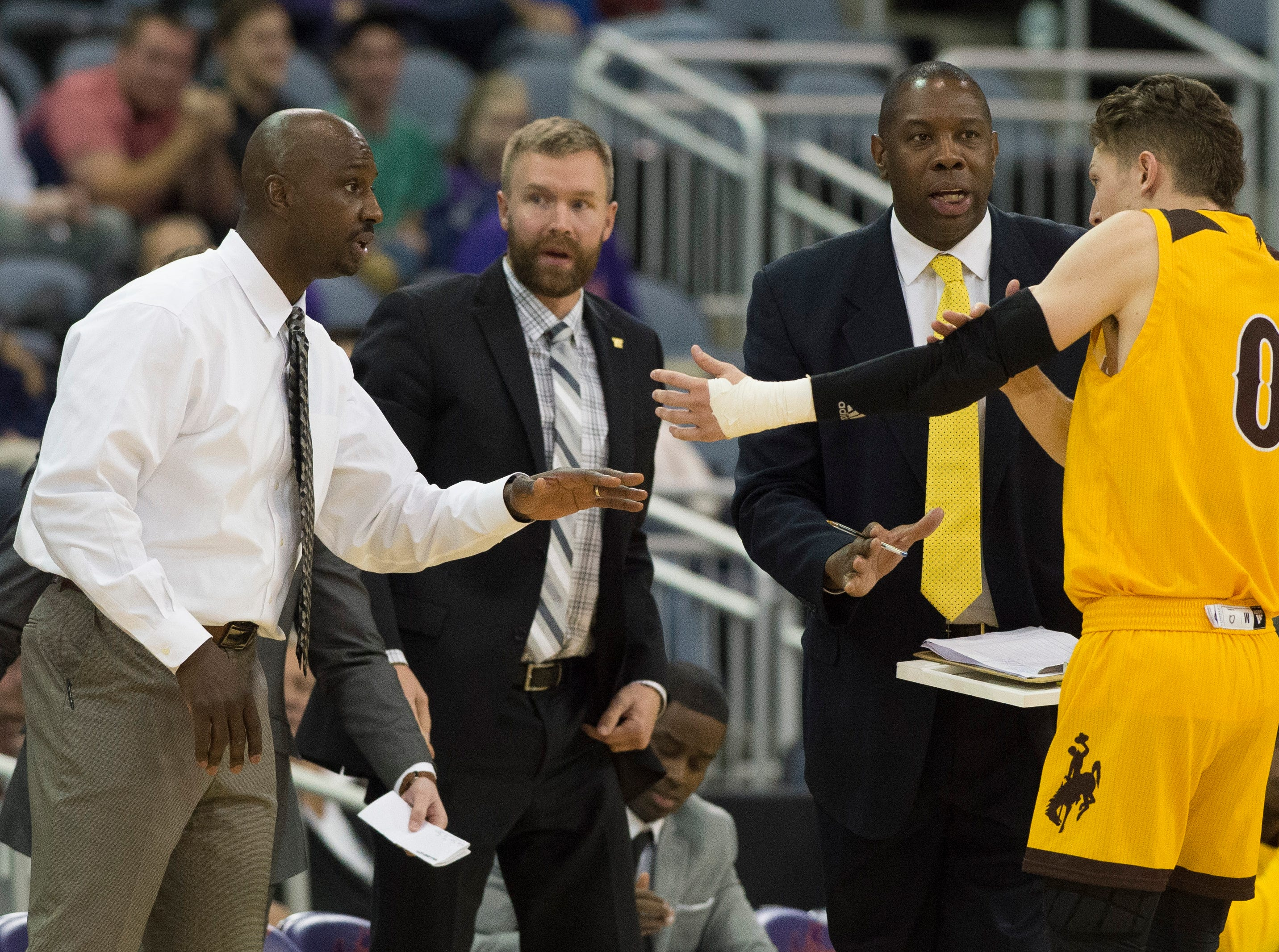 Wyoming's Head Coach Allen Edwards talks to Wyoming's Jake Hendricks (0) after Hendricks fouled out during the UE vs Wyoming game at the Ford Center Wednesday, Nov. 28, 2018. UE won 86-76.