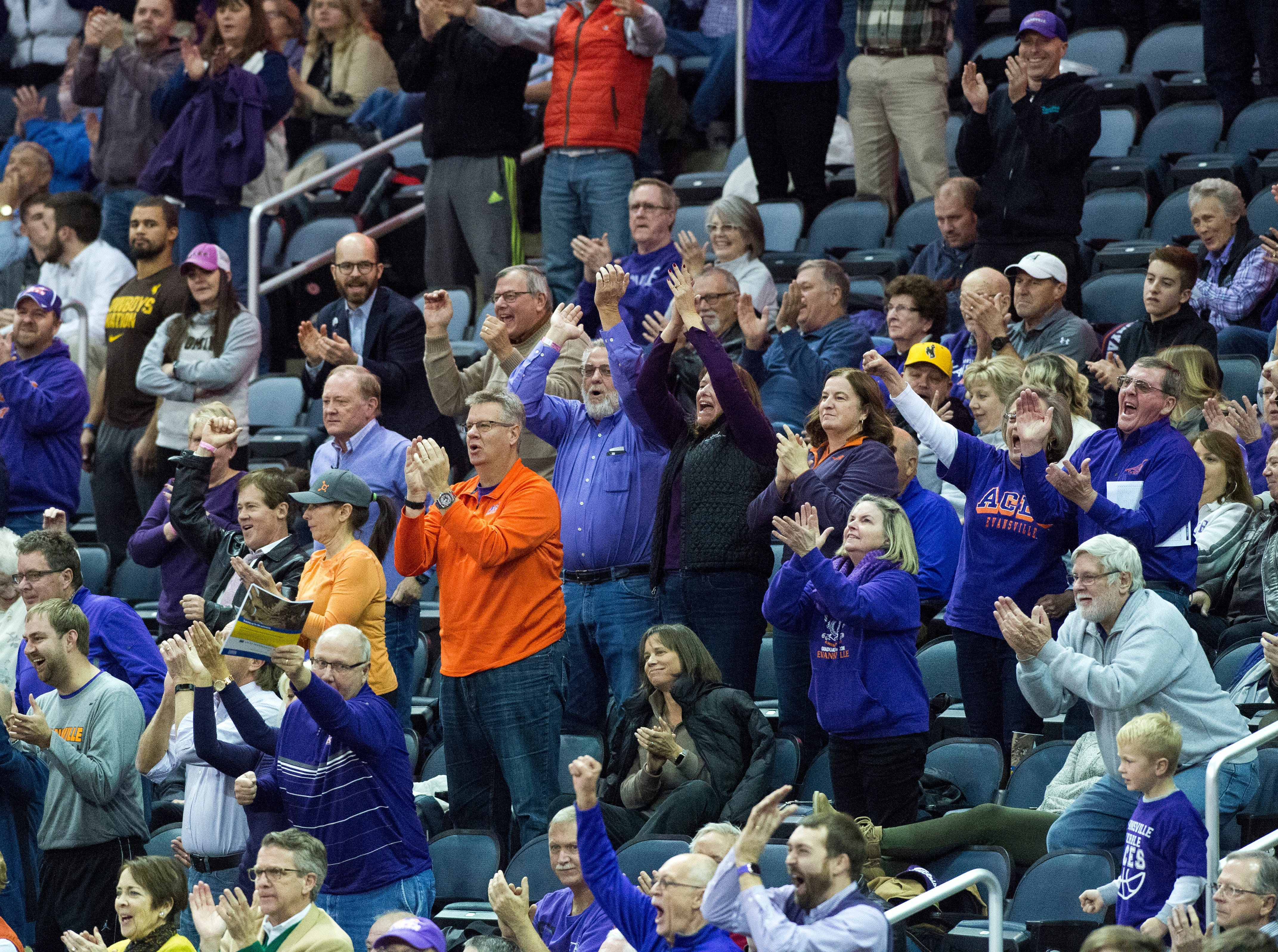 The crowds stands and cheers as the UE Men's basketball team beats Wyoming 86-76 at the Ford Center Wednesday, Nov. 28, 2018.
