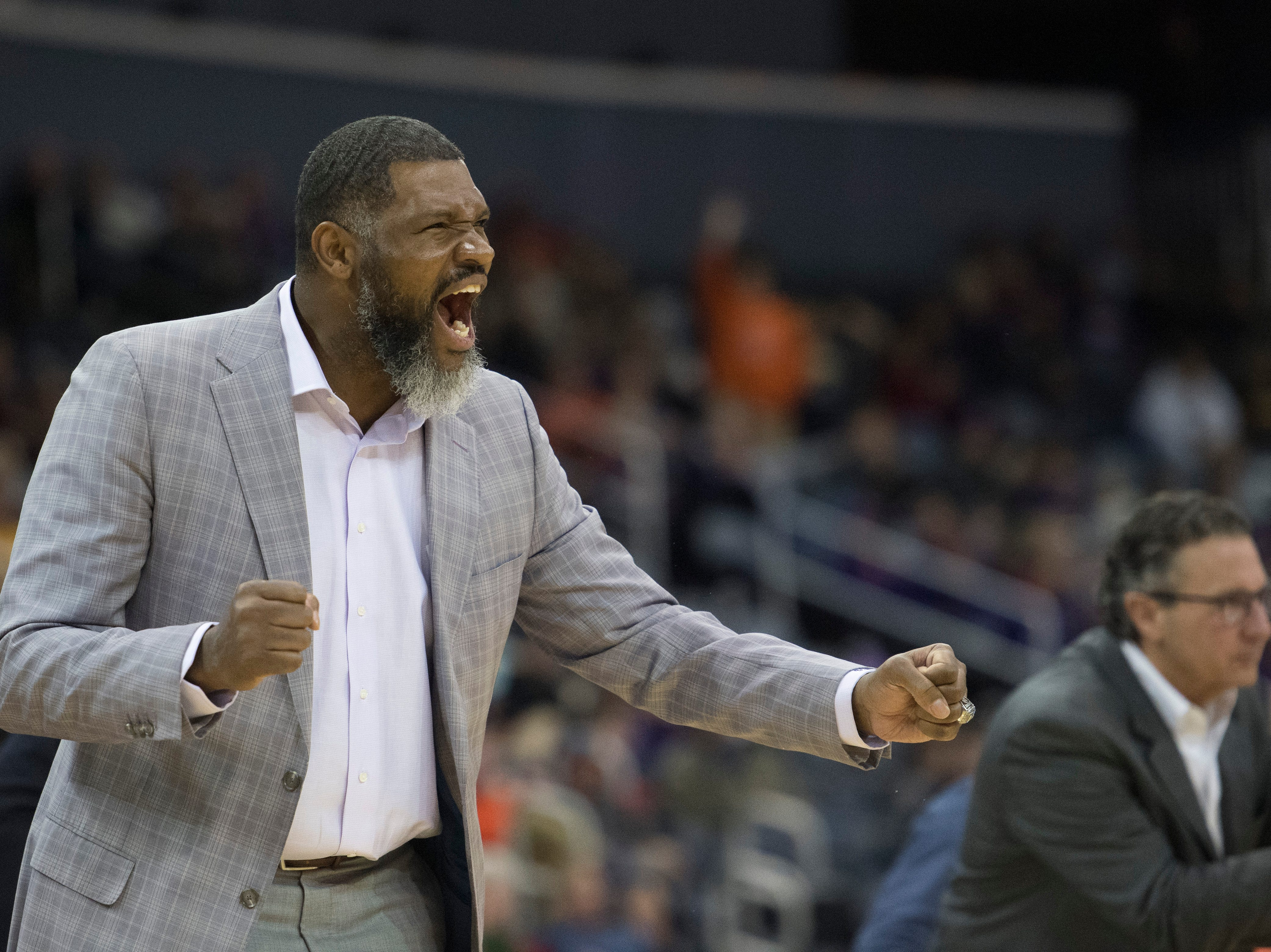 UE Head Coach Walter McCarty celebrates  during the UE vs Wyoming game at the Ford Center Wednesday, Nov. 28, 2018. UE won 86-76.