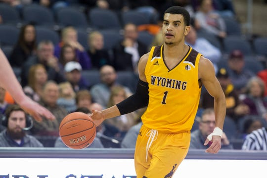 Wyoming's Justin James (1) looks for an open teammate during the UE vs Wyoming game at the Ford Center Wednesday, Nov. 28, 2018. UE won 86-76.