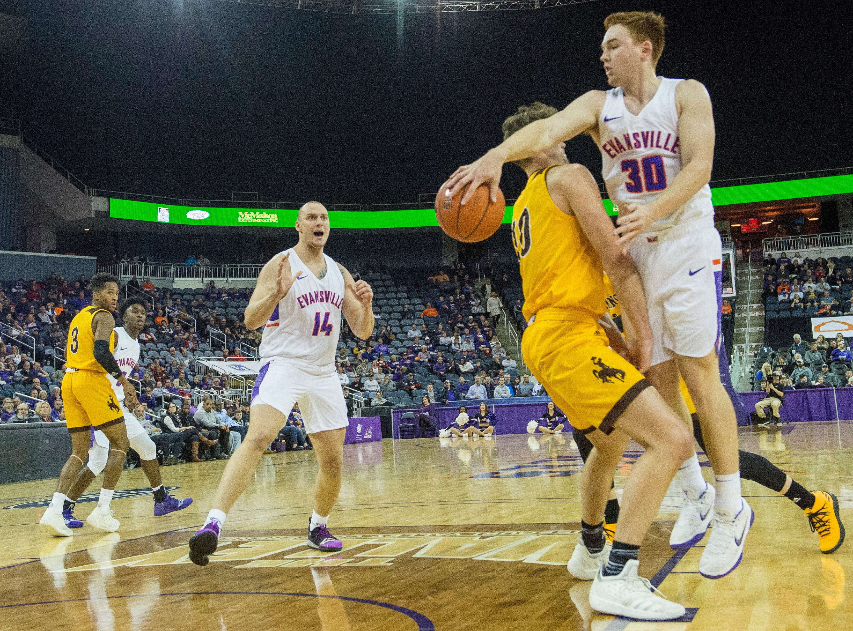 UE's Noah Frederking (30) passes the ball to UE's Dainius Charkevicius (14) during the UE vs Wyoming game at the Ford Center Wednesday, Nov. 28, 2018. UE won 86-76.