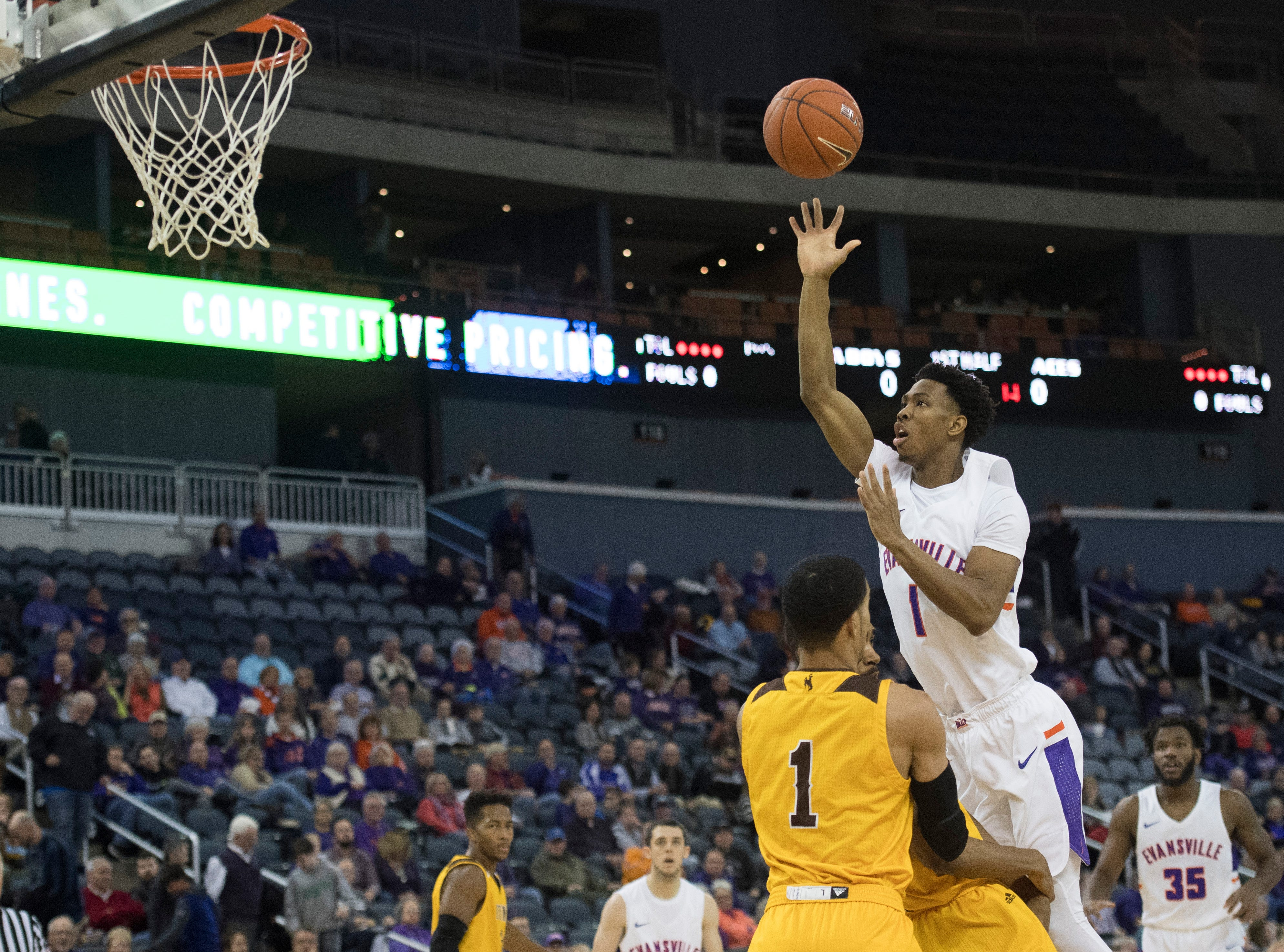 UE's Marty Hill (1) releases the ball during the UE vs Wyoming game at the Ford Center Wednesday, Nov. 28, 2018. UE won 86-76.