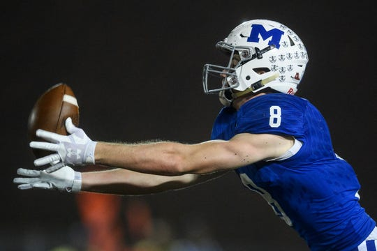 Memorial's Branson Combs (8) stretches for a pass from quarterback Michael Lindauer in the Tigers' romp over Vincennes Lincoln in the 3A sectional semis. Combs and LIndauer were named C&P All-Metro Co-Players of the Year.