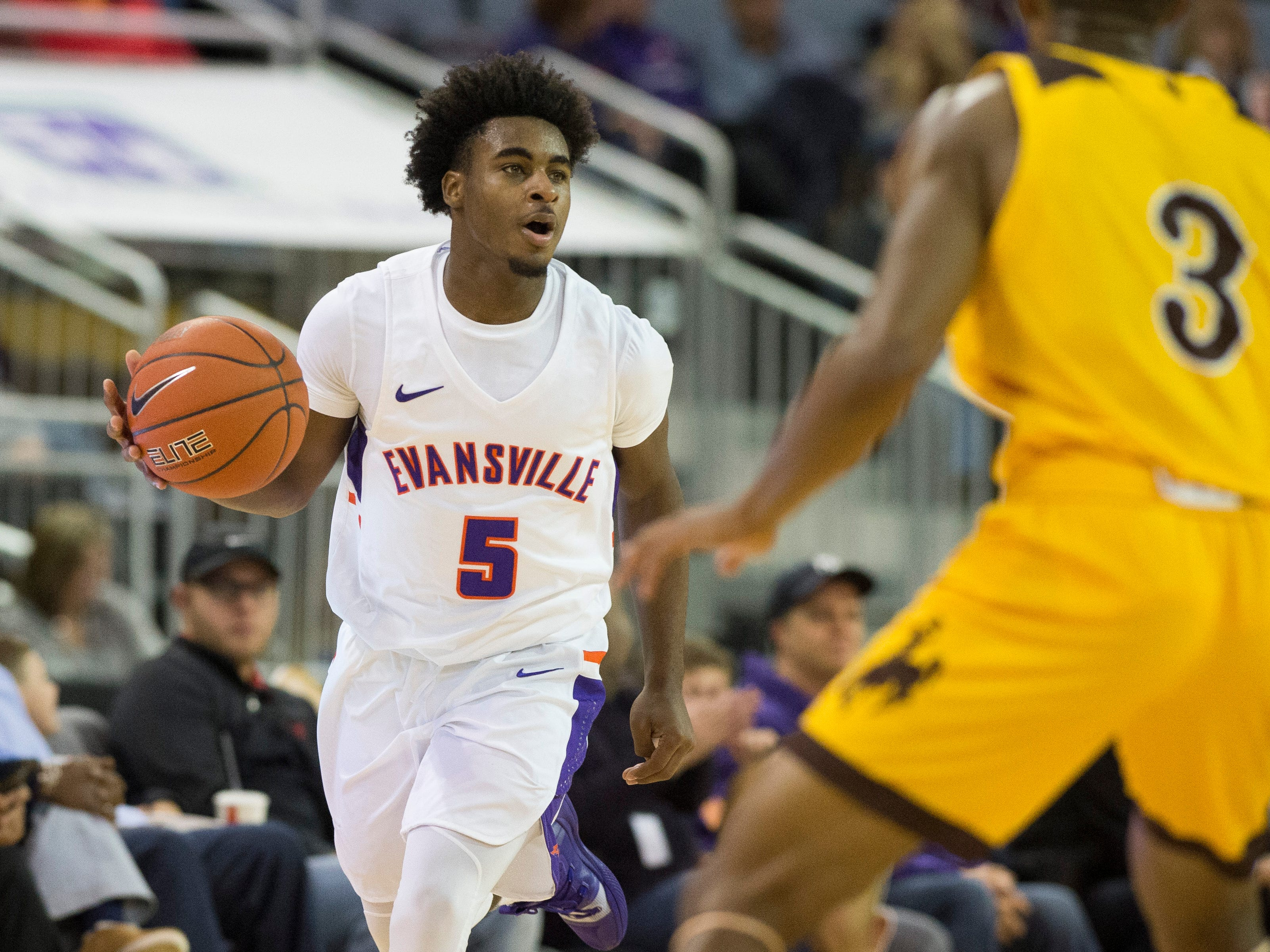 UE's Shamar Givance (5) dribbles the ball during the UE vs Wyoming game at the Ford Center Wednesday, Nov. 28, 2018. UE won 86-76.