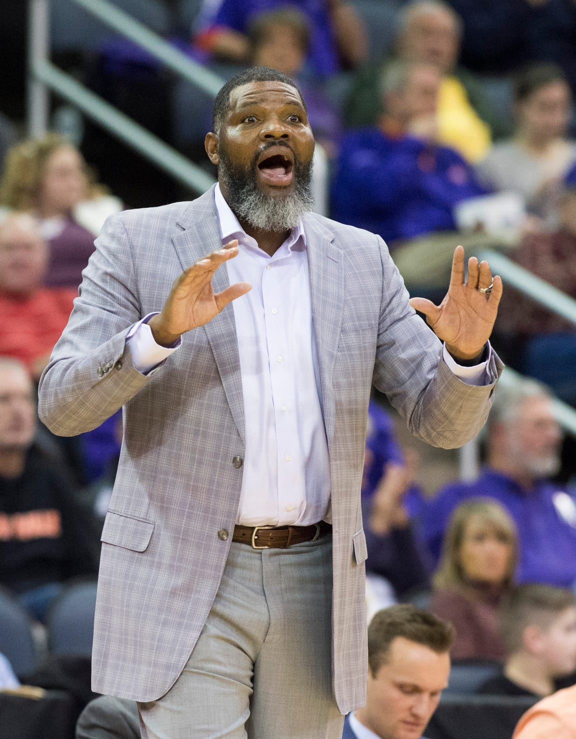 UE Head Coach Walter McCarty calls a play during the UE vs Wyoming game at the Ford Center Wednesday, Nov. 28, 2018. McCarty and Wyoming's Head Coach Allen Edwards were teammates when they played for Kentucky in 1996.