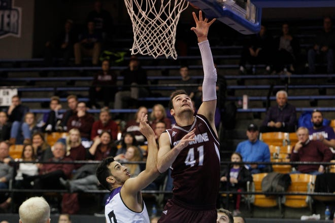 Bellarmine University's Adam Eberhard scores against Kentucky Wesleyan during a Nov. 14 game in Owensboro.