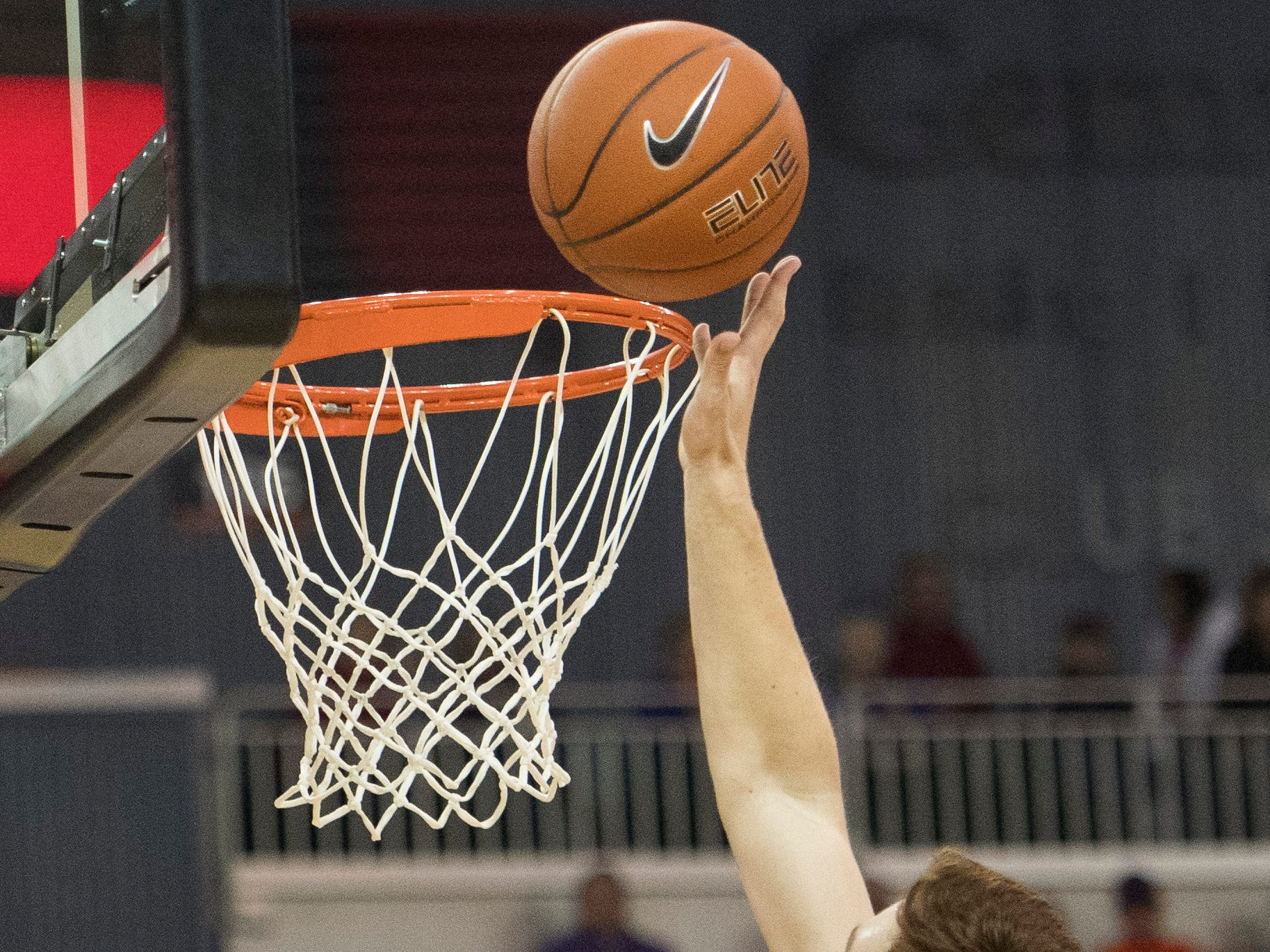 UE's Noah Frederking (30) tips the ball into the basket  during the UE vs Wyoming game at the Ford Center Wednesday, Nov. 28, 2018. UE won 86-76.