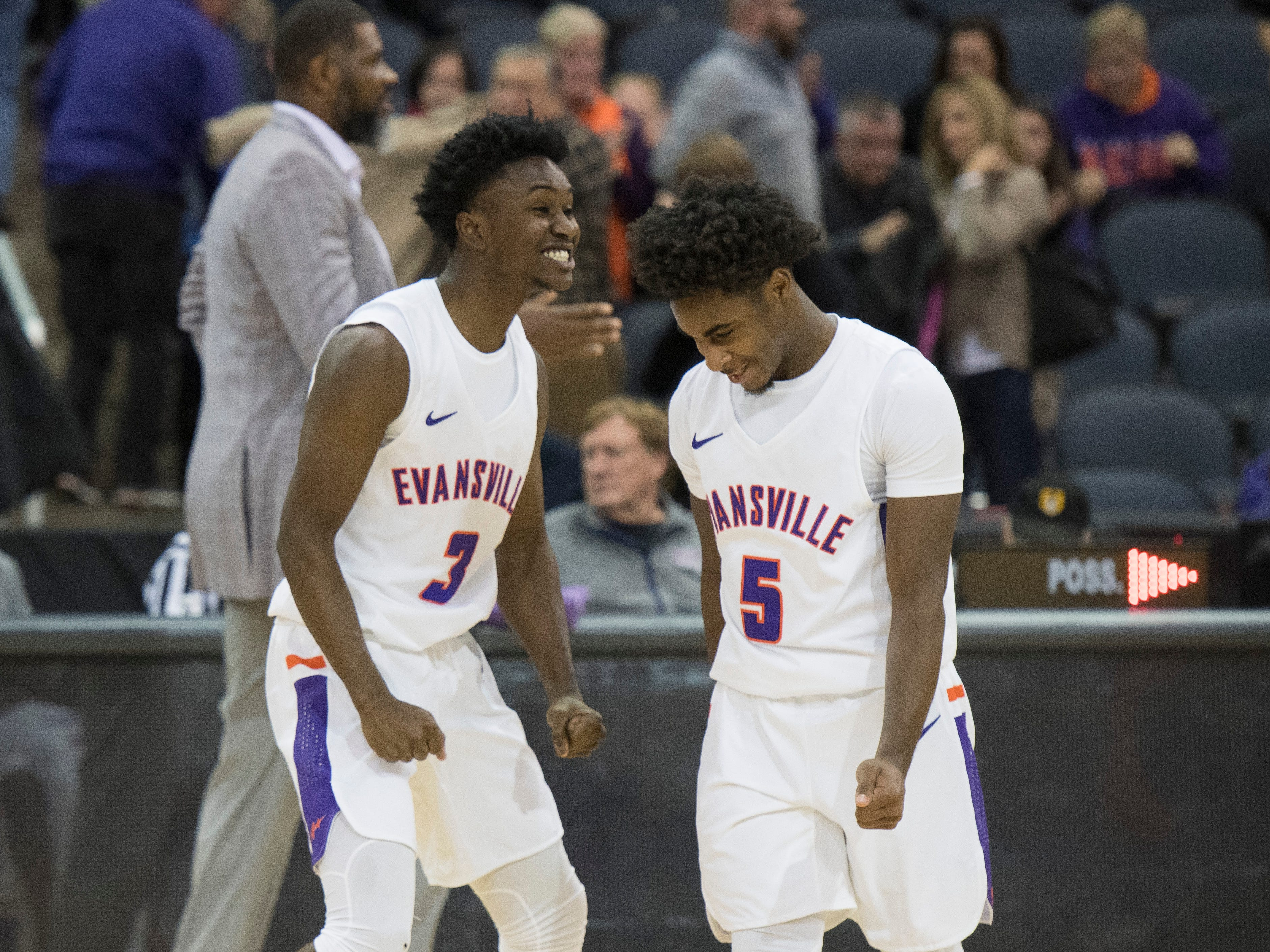 UE's Jawaun Newton (3) celebrates with Shamar Givance (5) after the 86-76 viceroy over Wyoming at the Ford Center Wednesday, Nov. 28, 2018.
