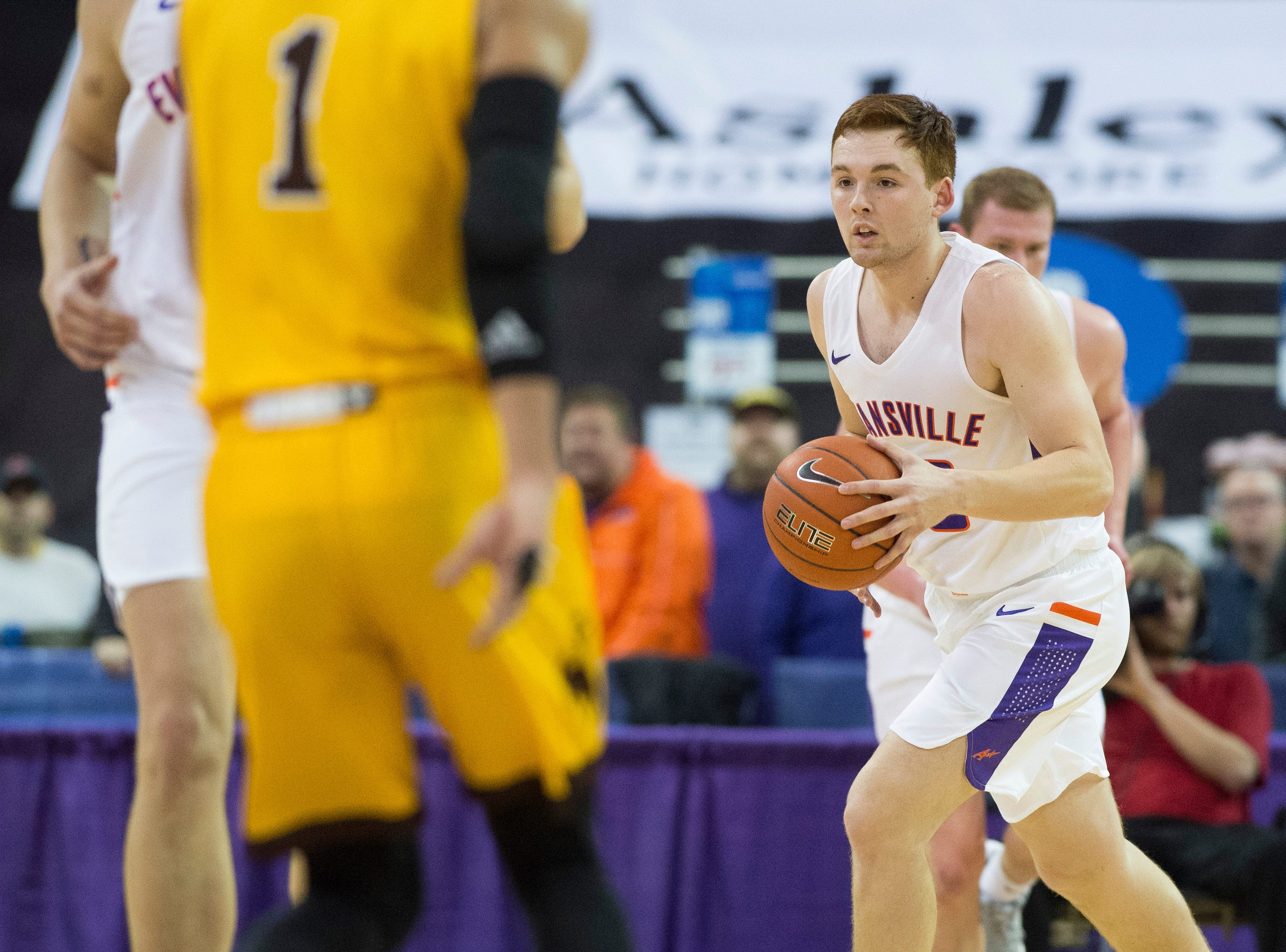 UE's Noah Frederking (30) looks for an open teammate during the UE vs Wyoming game at the Ford Center Wednesday, Nov. 28, 2018. UE won 86-76.