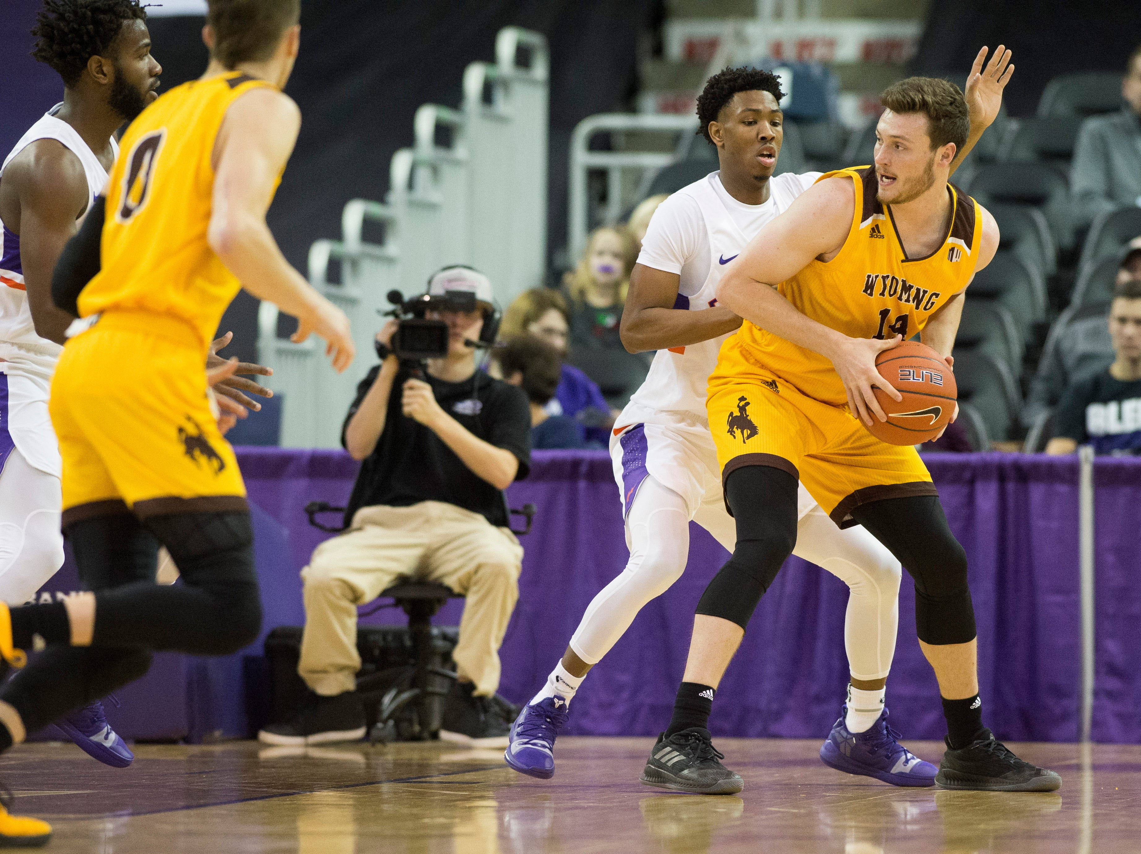 Wyoming's Austin Mueller is guarded by UE's Marty Hill (1) during the UE vs Wyoming game at the Ford Center Wednesday, Nov. 28, 2018. UE won 86-76.