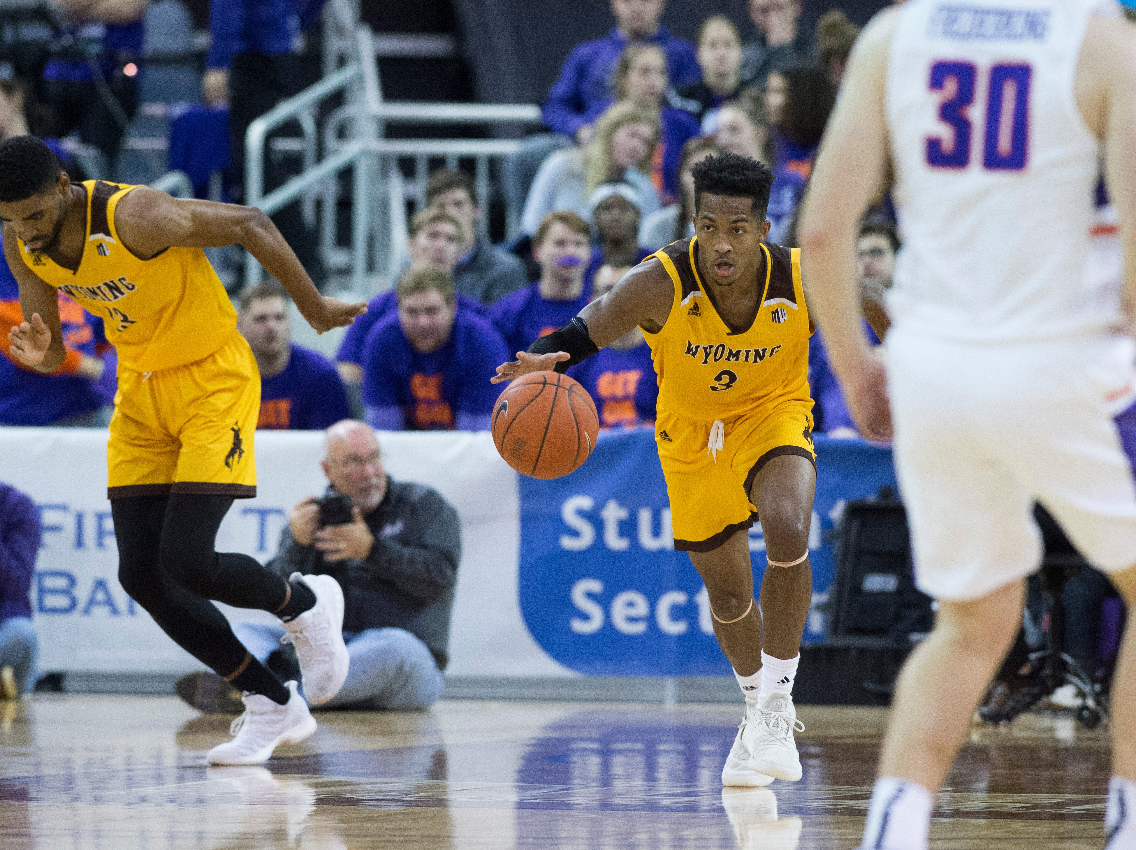 Wyoming's Nyaires Redding (3) dribbles the ball down court during the UE vs Wyoming game at the Ford Center Wednesday, Nov. 28, 2018. UE won 86-76.