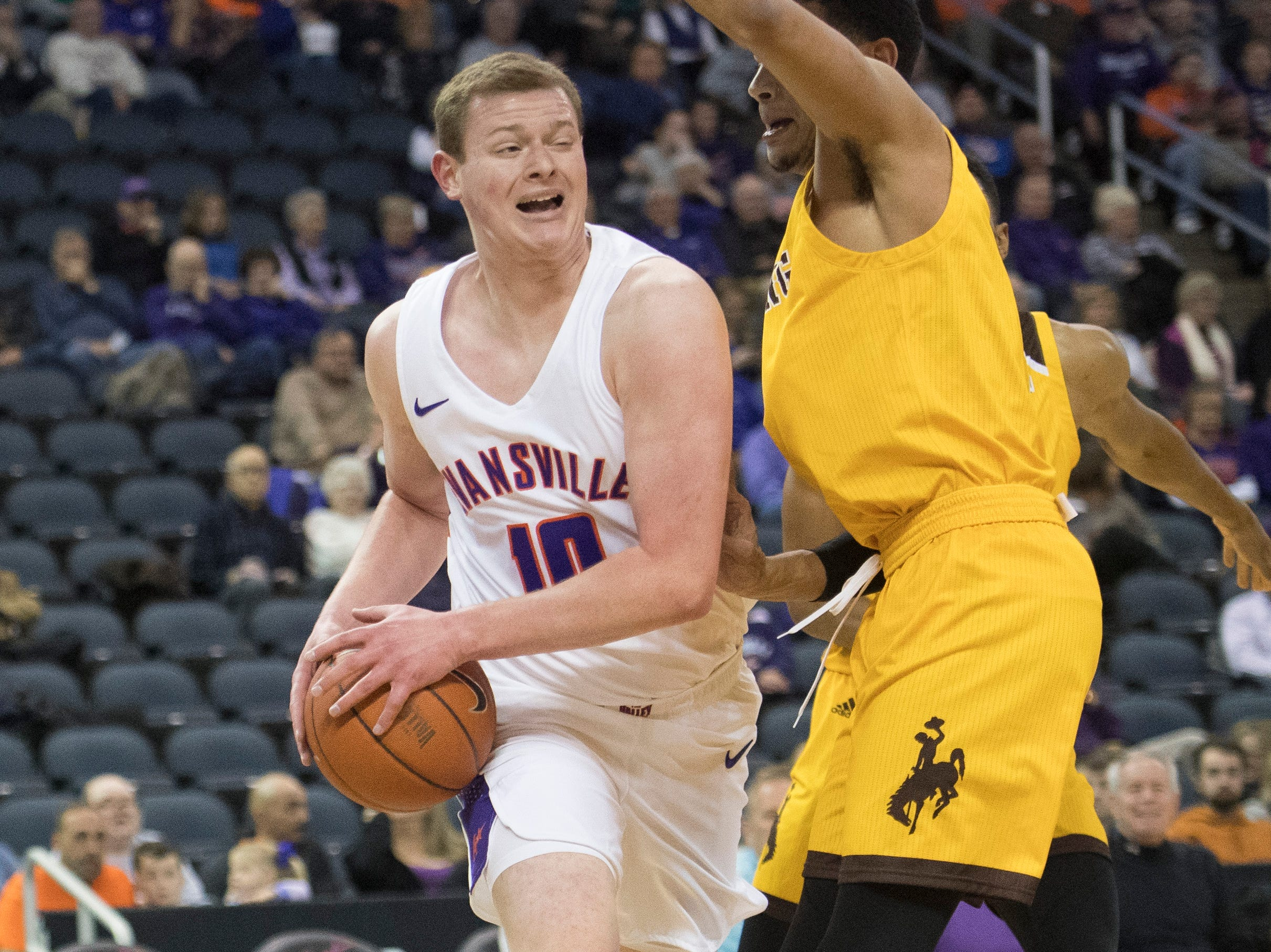 Wyoming defense tries to force UE's Evan Kuhlman (10) out of bounds during the UE vs Wyoming game at the Ford Center Wednesday, Nov. 28, 2018. UE won 86-76.