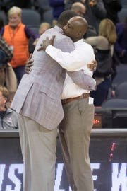 UE Head Coach Walter McCarty hugs Wyoming's Head Coach Allen Edwards after the UE vs Wyoming game at the Ford Center Wednesday. UE won 86-76. Edwards and McCarty played for Kentucky together in 1996.