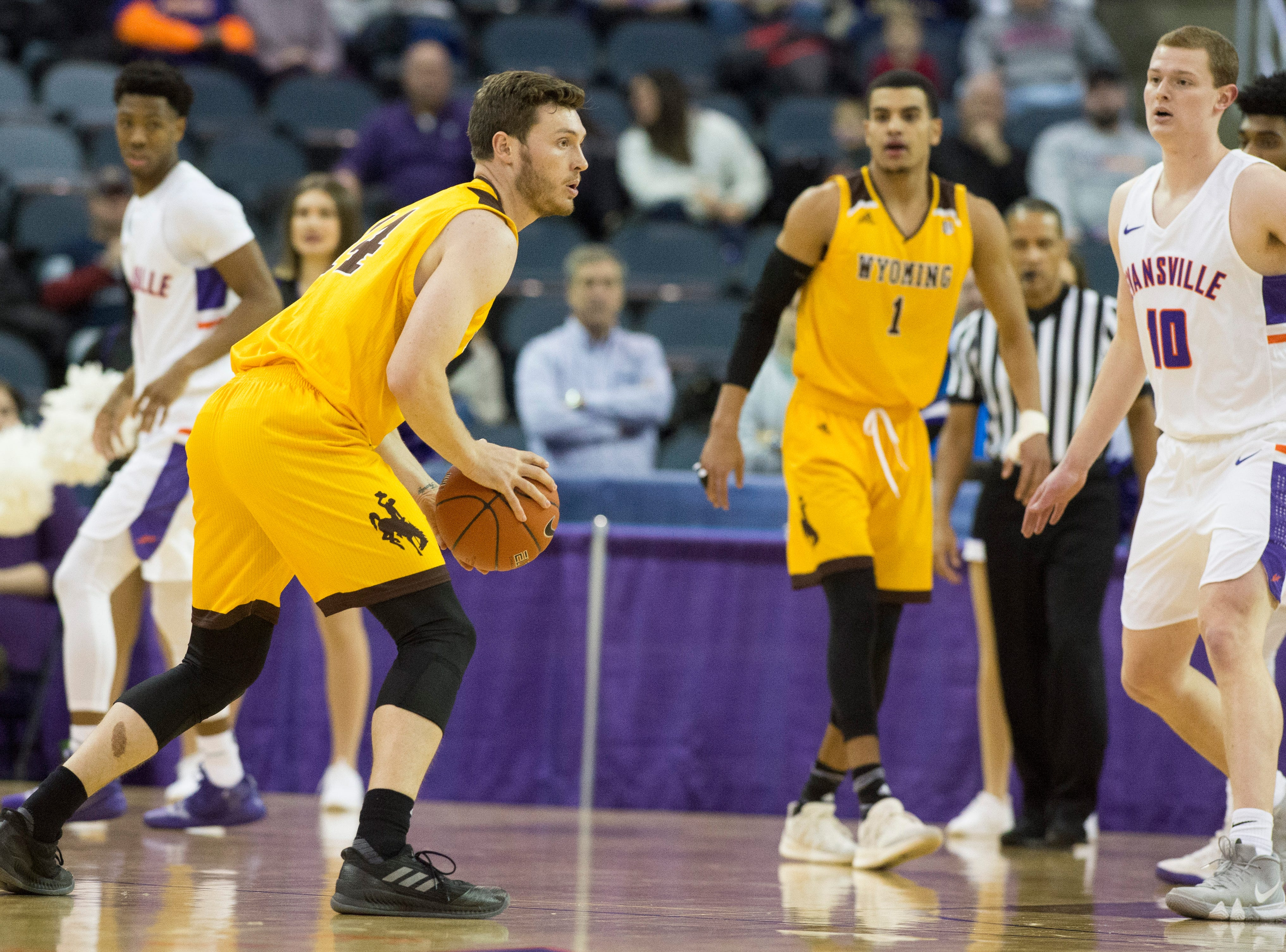 Wyoming's Austin Mueller looks to pass the ball during the UE vs Wyoming game at the Ford Center Wednesday, Nov. 28, 2018. UE won 86-76.