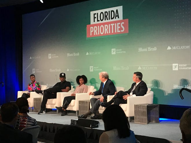 A group of panelists discuss gun violence at the Miami Herald's Florida Priorities Summit