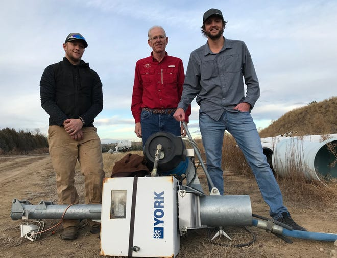 From left are PSD Nordic ski team assistant coach, Jasper Gantrick, Colorado Youth Outdoor director of operations Gregg Knoll and ski team head coach Kyle Steitz standing behind a snow-making machine on the CYO property, where the team will train.