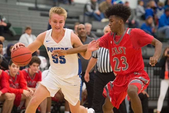 Poudre's Jake Fisher tries to get around Kemani Dickerson of Denver East during the GoJo's Tipoff Classic tournament at Fossil Ridge High School on Wednesday, November 28, 2018.