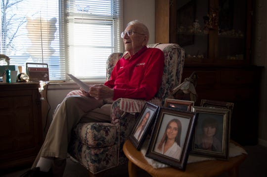 Chuck Kavalec reads a birthday message he received from the Denver Broncos football team in his favorite chair at his Fort Collins home on Thursday, November 29, 2018. Kavalec turns 100 years old on Dec. 5.