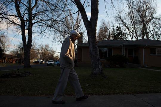 Chuck Kavalec takes his routine 1-mile walk through his neighborhood on Thursday, November 29, 2018. Kavalec turns 100 years old on Dec. 5.