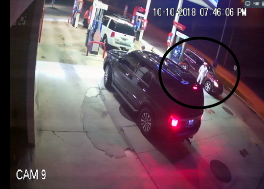 One of the suspects stood outside the car they drove to the gas station, authorities said.