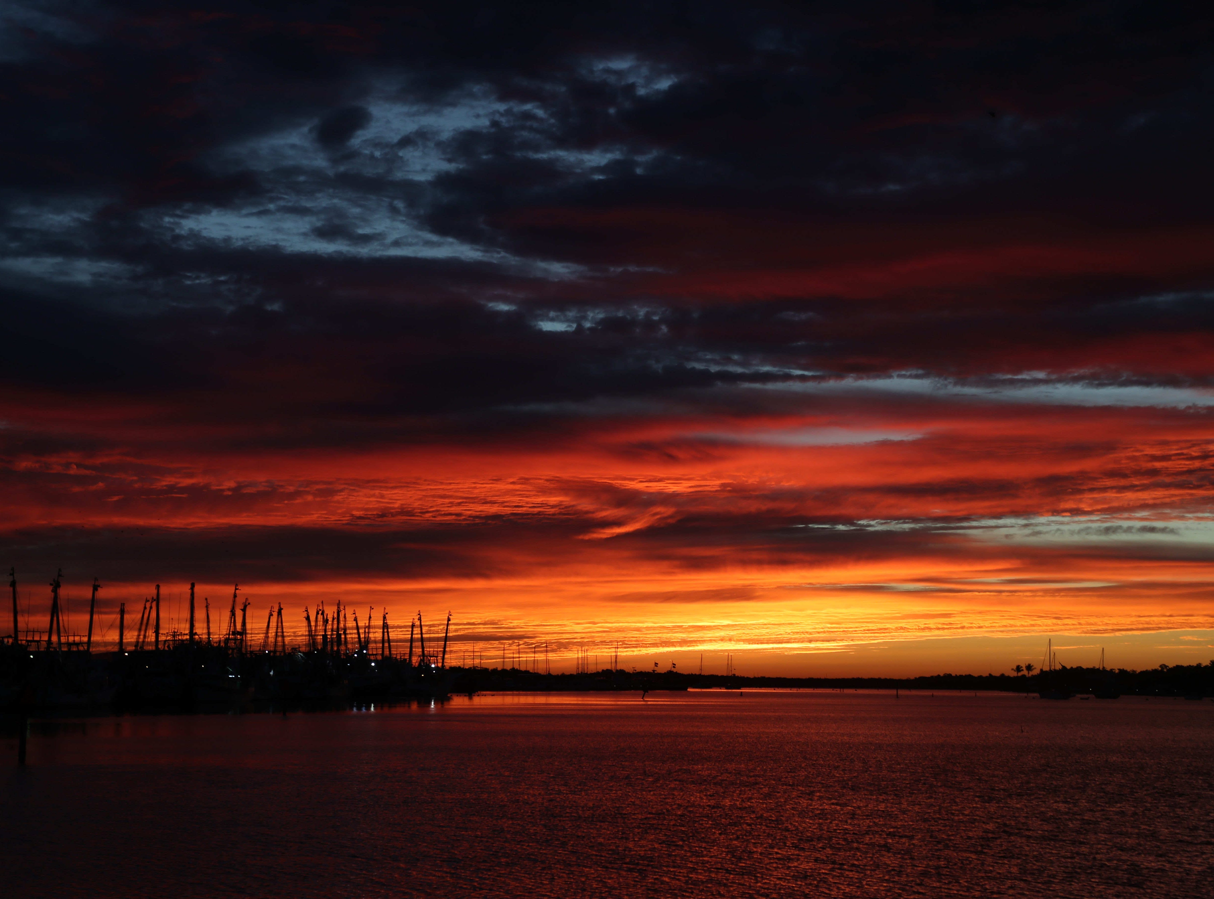The sunrise on Thursday 11/29/2018 was spectacular. Photographed from the Bonita Bills and Doc Ford's under the Matanzas Bridge on Fort Myers Beach.